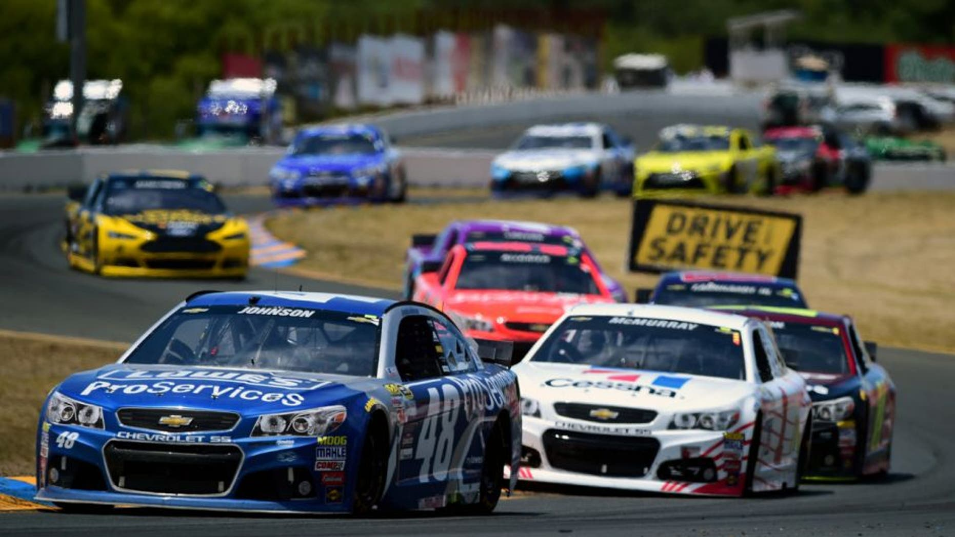 SONOMA, CA - JUNE 28: Jimmie Johnson, driver of the #48 Lowe's Pro Services Chevrolet, leads a pack of cars during the NASCAR Sprint Cup Series Toyota/Save Mart 350 at Sonoma Raceway on June 28, 2015 in Sonoma, California. (Photo by Jared C. Tilton/Getty Images)