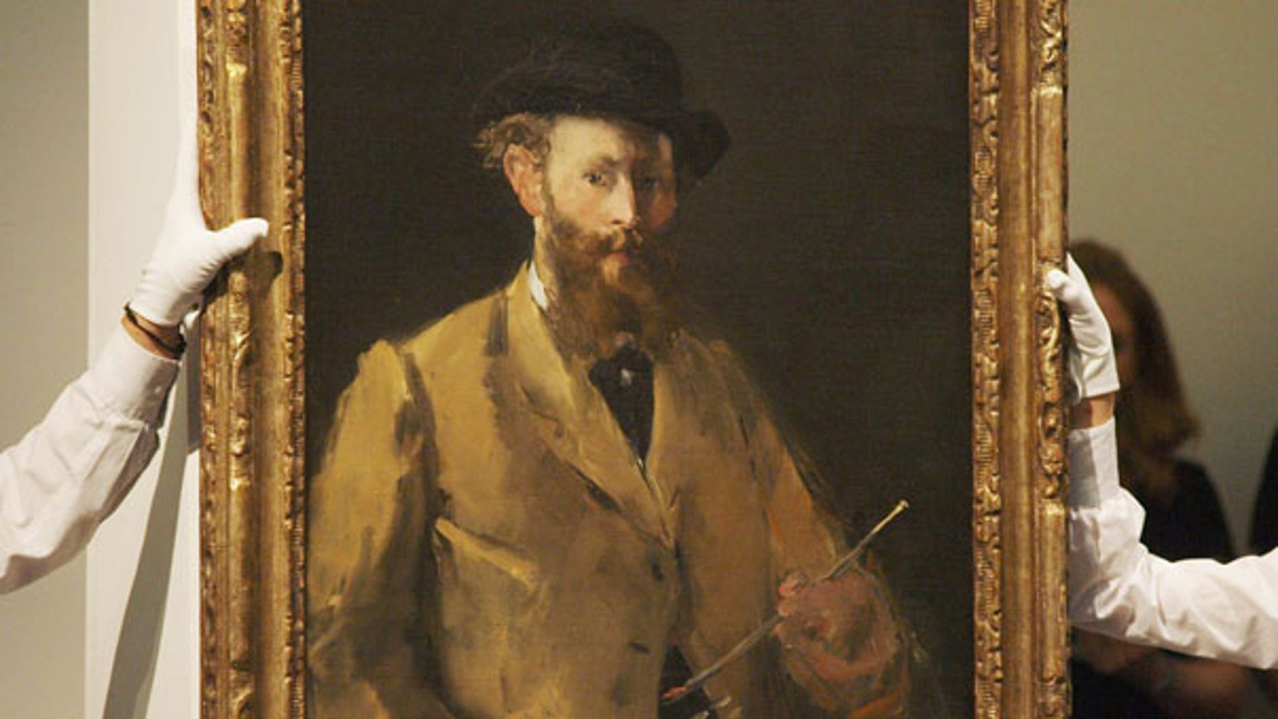 June 22: View of French Impressionist Edouard Manet's 'Self Portrait,' which sold at auction at Sotheby's in London for $33 million.
