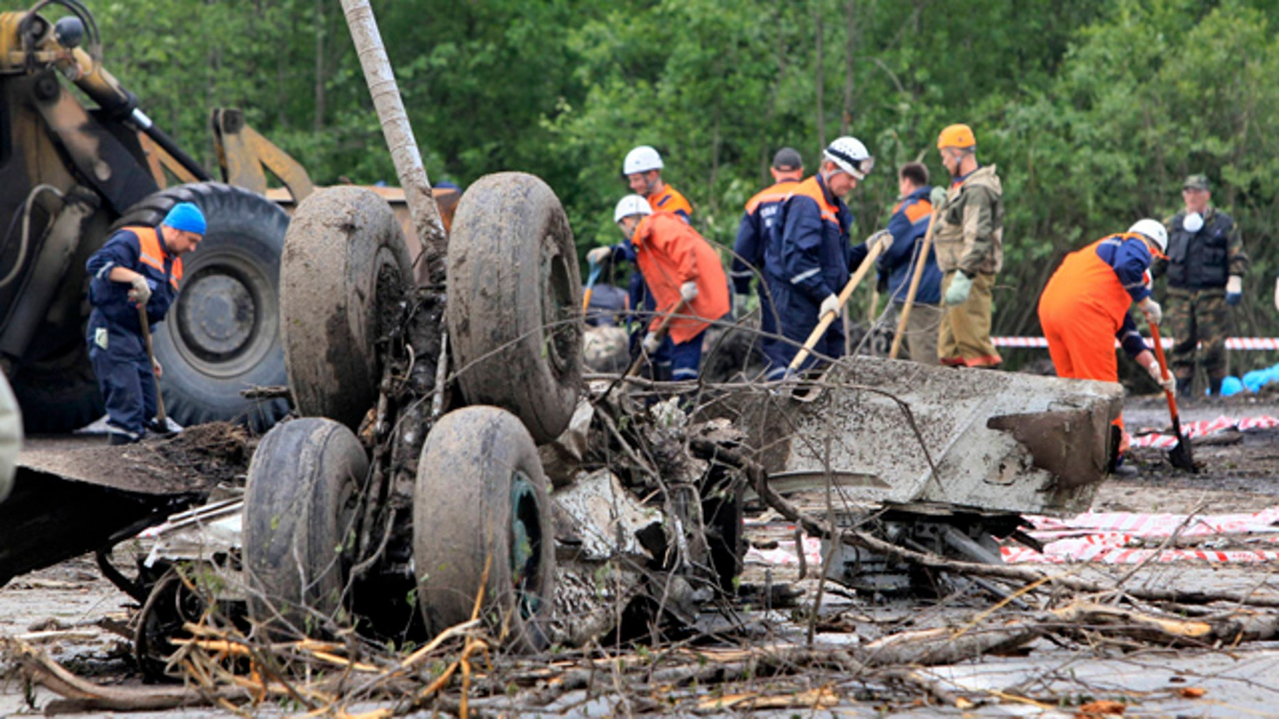 June 21: Emergency workers and investigators search wreckage of Tu-134 plane, belonging to the RusAir airline, near the city of Petrozavodsk.