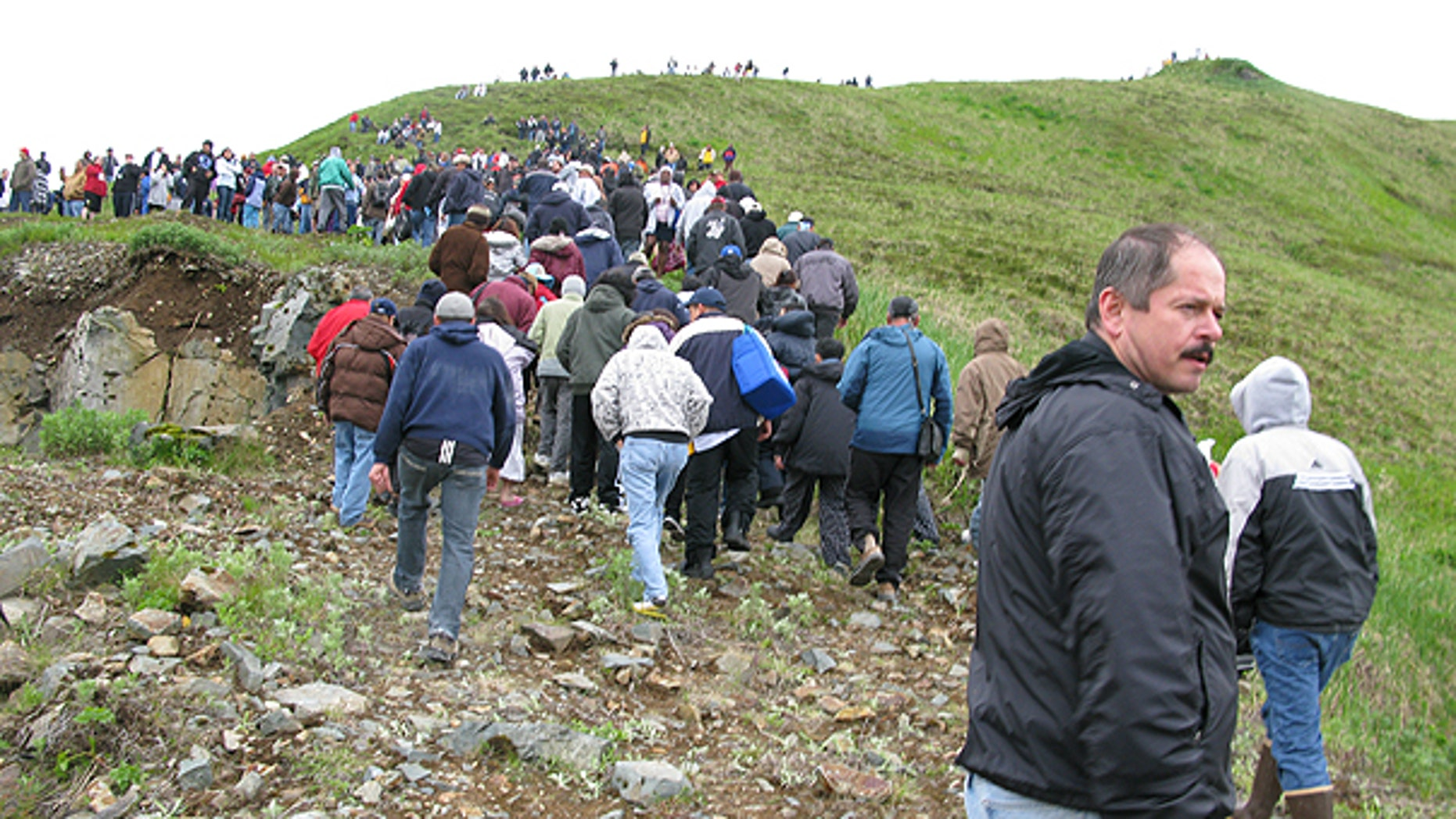 June 23: Fish processing workers and local residents head up the hill after a tsunami warning was issued in Unalaska's Dutch Harbor, in Alaska's Aleutian Islands.