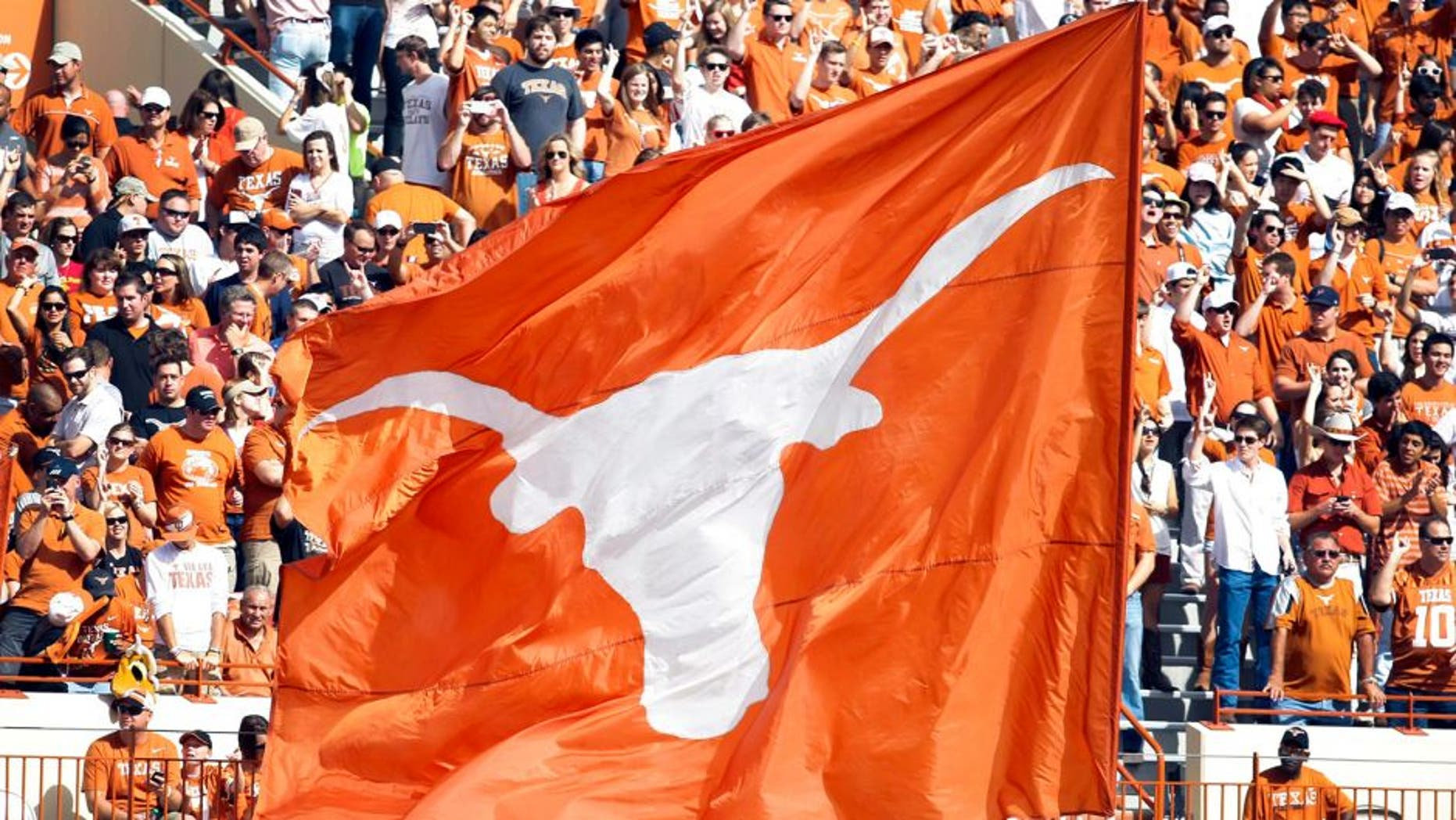 Nov 10, 2012; Austin, TX, USA; Texas Longhorns cheerleaders wave a flag after a touchdown against the Iowa State Cyclones in the first quarter at Darrell K Royal-Texas Memorial Stadium. Mandatory Credit: Brett Davis-USA TODAY Sports