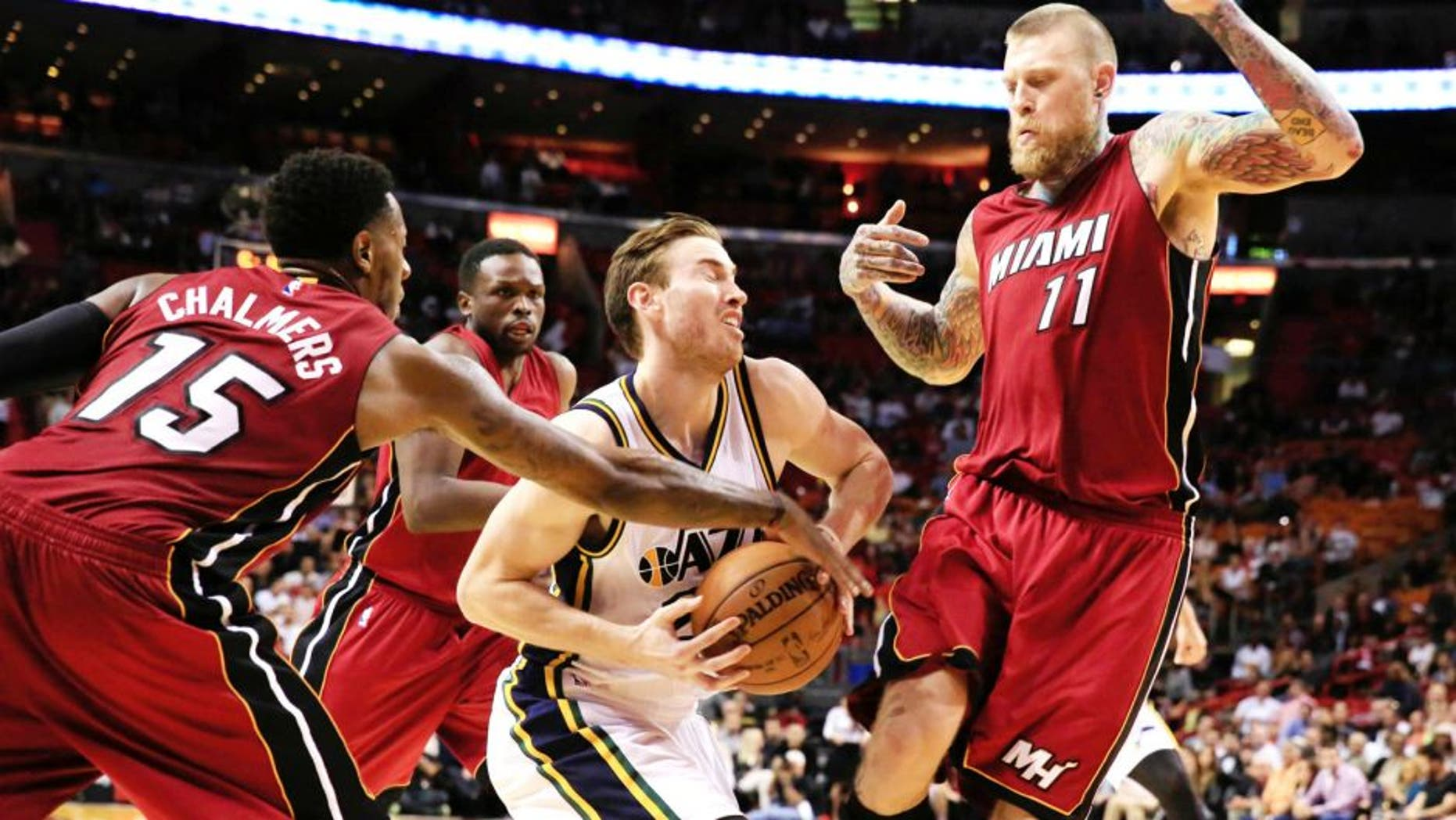 Dec 17, 2014; Miami, FL, USA; Utah Jazz forward Gordon Hayward (20) is defended by Miami Heat guard Mario Chalmers (15) and forward Chris Andersen (11) in the second half at American Airlines Arena. The Jazz won 105-87. Mandatory Credit: Robert Mayer-USA TODAY Sports