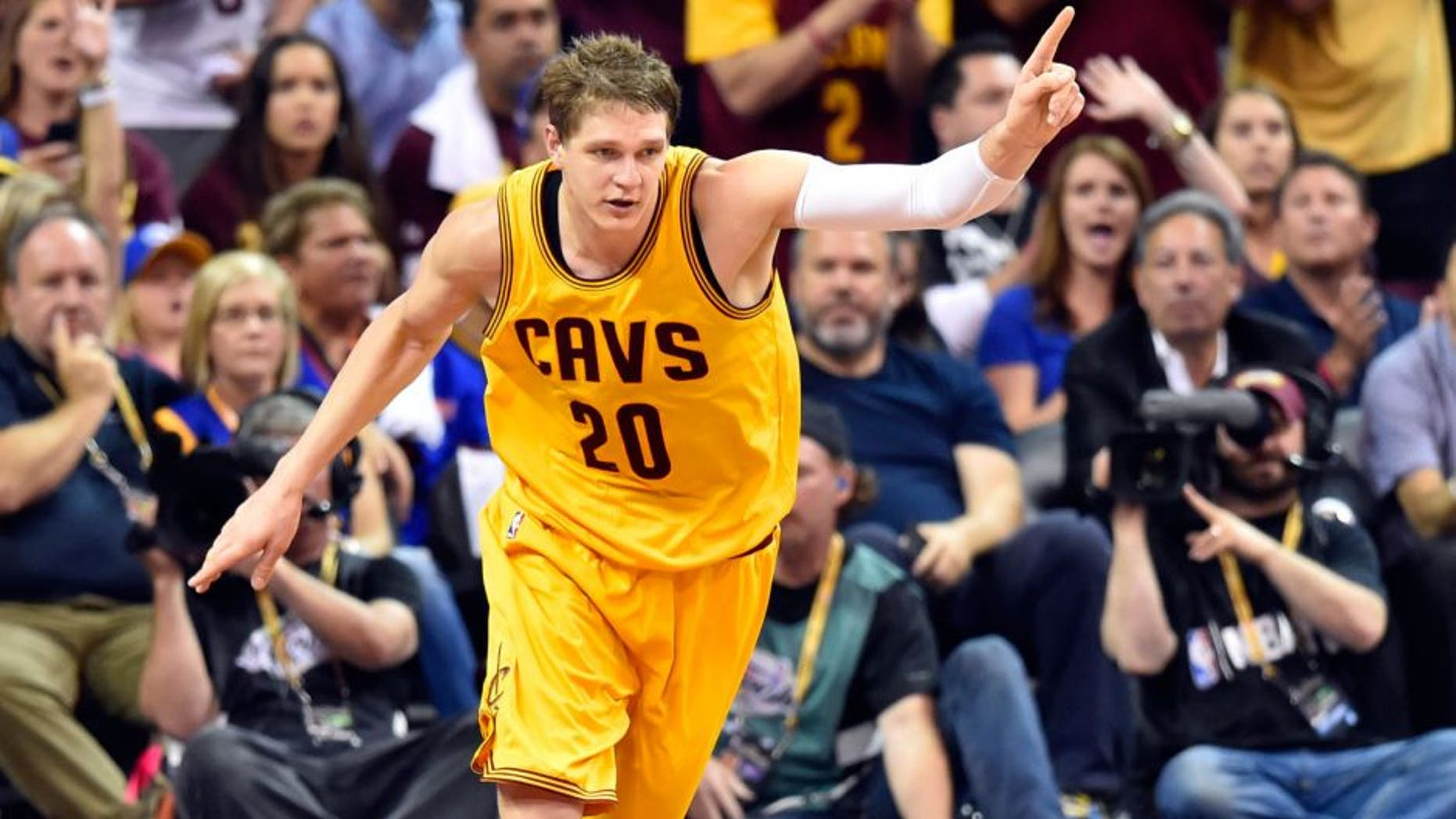 Jun 11, 2015; Cleveland, OH, USA; Cleveland Cavaliers center Timofey Mozgov (20) reacts during the third quarter of game four of the NBA Finals against the Golden State Warriors at Quicken Loans Arena.