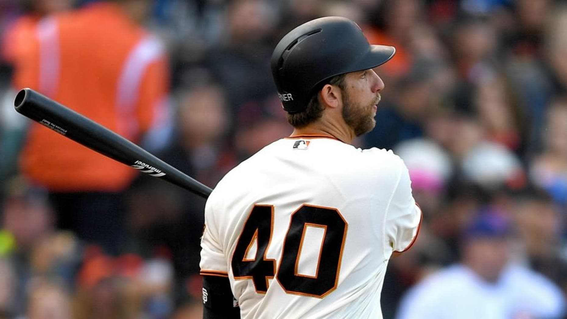 SAN FRANCISCO, CA - MAY 22: Madison Bumgarner #40 of the San Francisco Giants hits an rbi double scoring Gregor Blanco #7 against the Chicago Cubs in the bottom of the fifth inning at AT&T Park on May 22, 2016 in San Francisco, California. (Photo by Thearon W. Henderson/Getty Images)