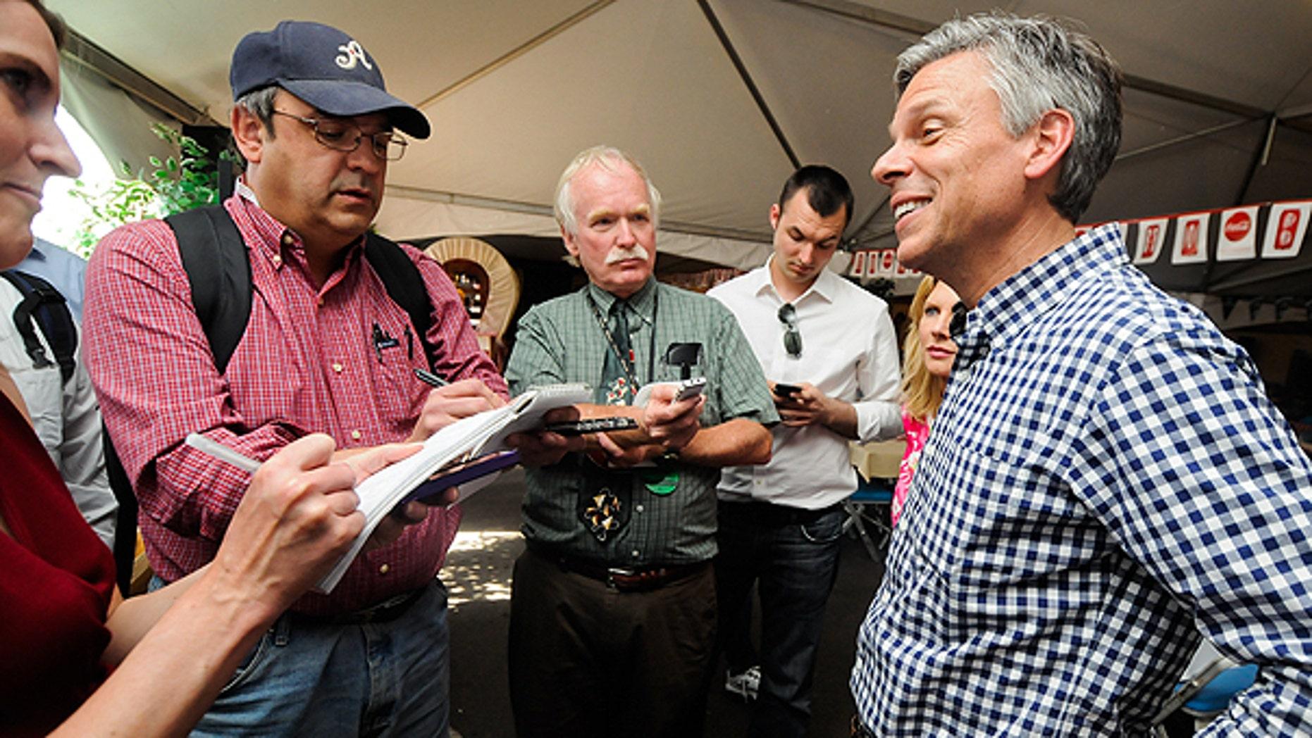 June 24: Former Utah Gov. Jon Huntsman talks to the media during a campaign stop at the Reno Rodeo in Reno, Nev.