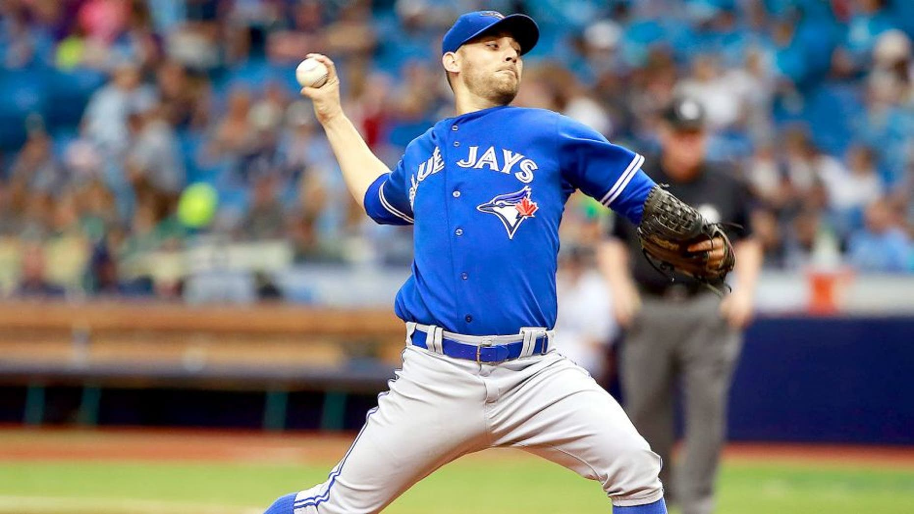 Jun 24, 2015; St. Petersburg, FL, USA; Toronto Blue Jays relief pitcher Marco Estrada (25) throws a pitch during the third inning against the Tampa Bay Rays at Tropicana Field. Mandatory Credit: Kim Klement-USA TODAY Sports
