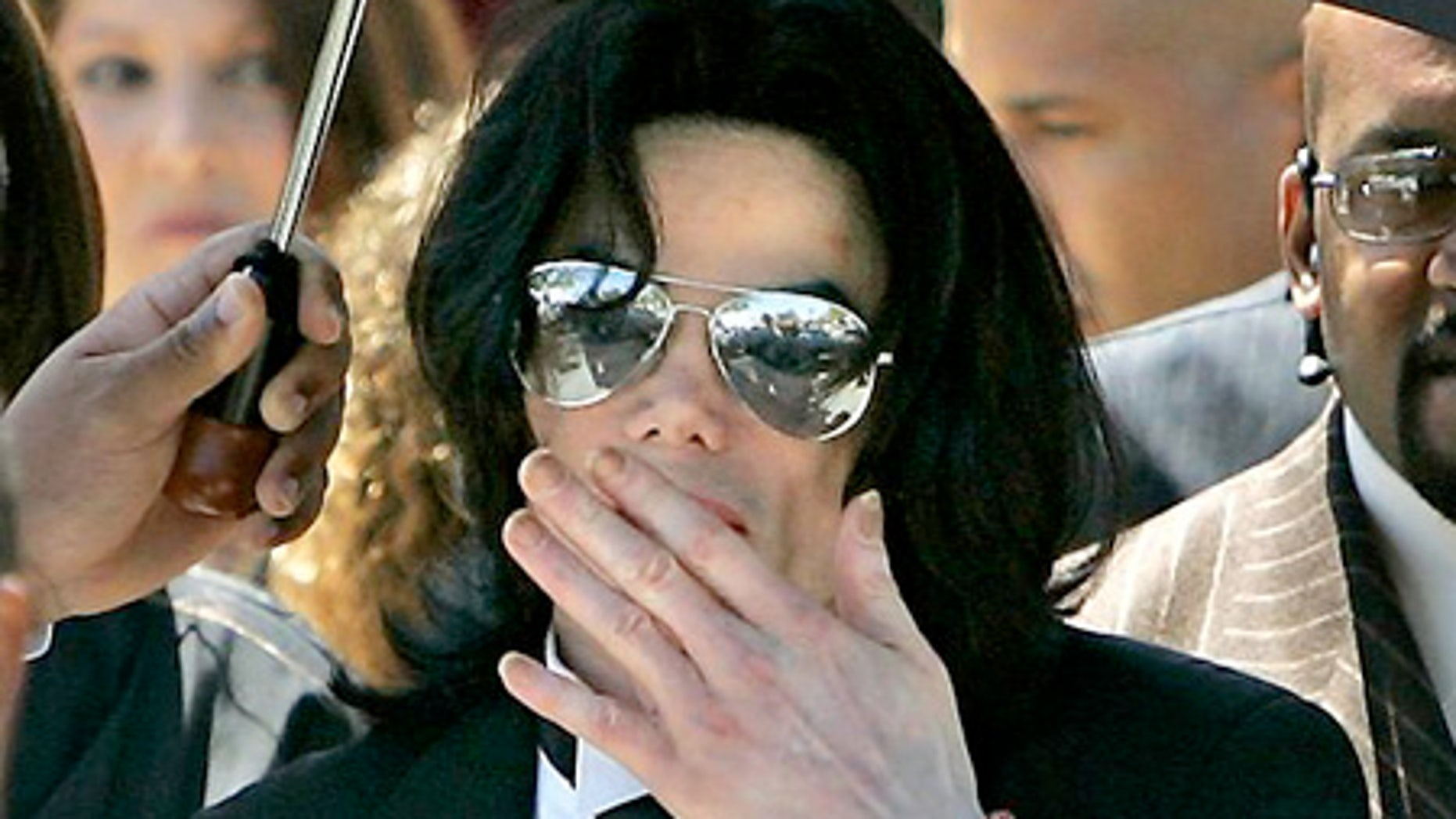 June 13, 2005: Michael Jackson blows a kiss to his fans as he leaves the Santa Barbara County Courthouse in Santa Maria, Calif.