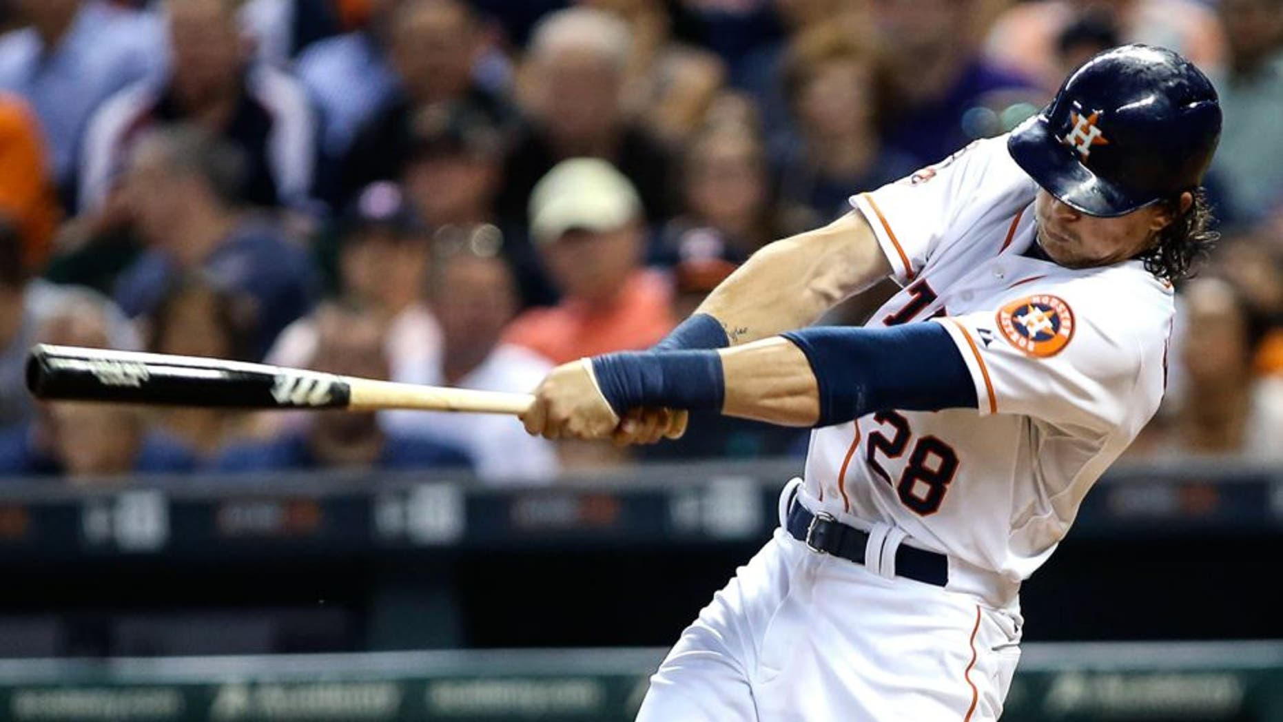 Jun 25, 2015; Houston, TX, USA; Houston Astros center fielder Colby Rasmus (28) drives in a run with a sacrifice fly during the fourth inning against the New York Yankees at Minute Maid Park. Mandatory Credit: Troy Taormina-USA TODAY Sports