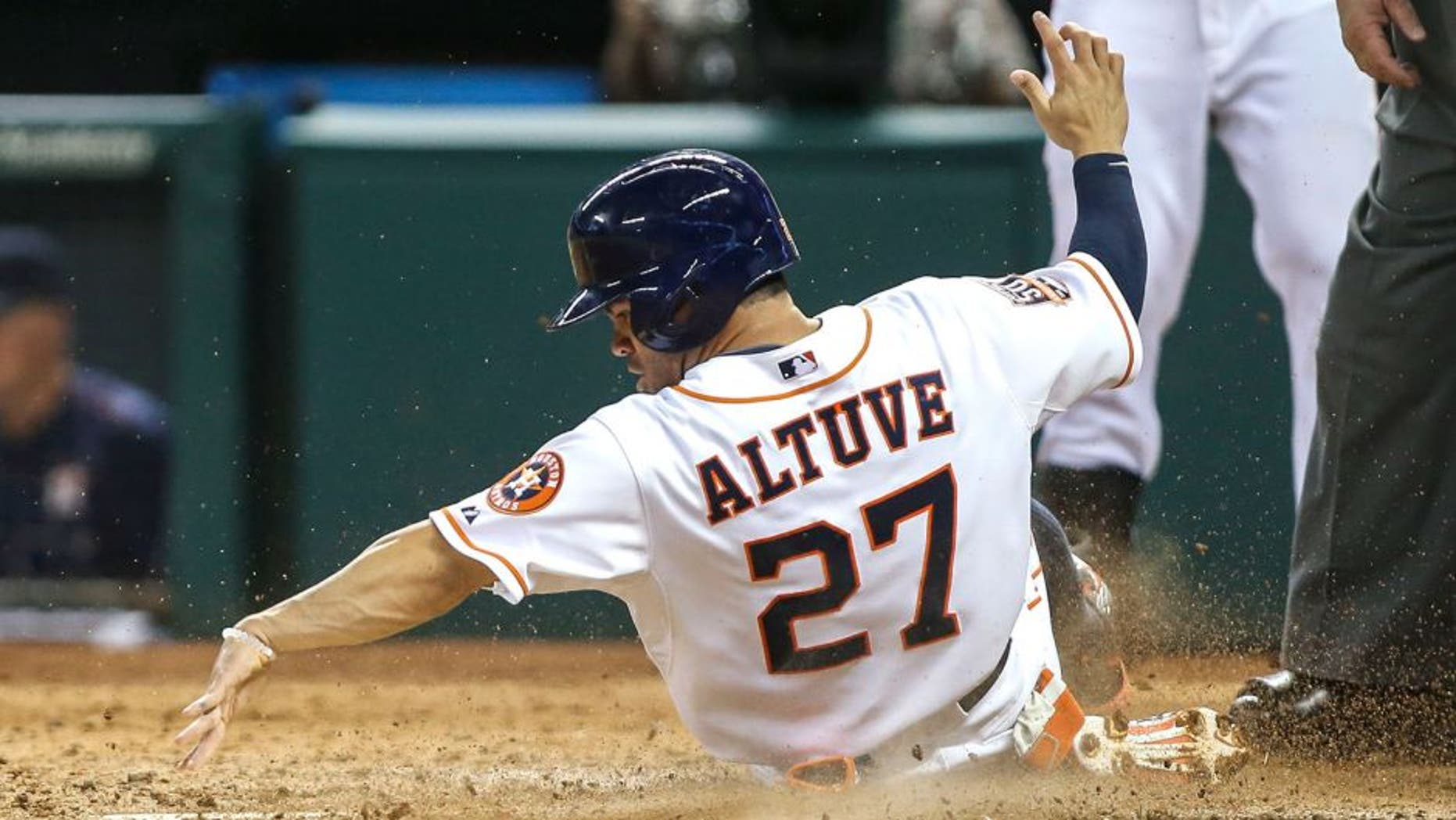 Jun 25, 2015; Houston, TX, USA; Houston Astros second baseman Jose Altuve (27) touches home plate as he scores a run during the fourth inning against the New York Yankees at Minute Maid Park. Mandatory Credit: Troy Taormina-USA TODAY Sports