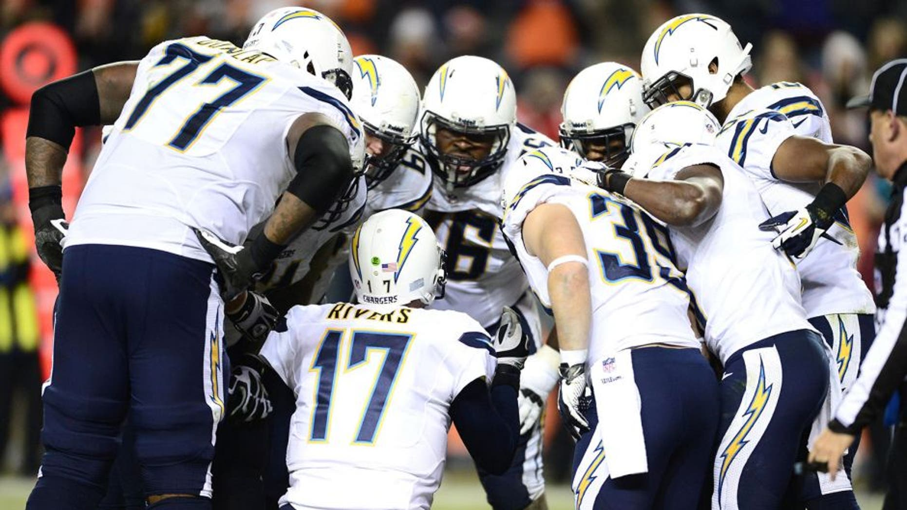 Dec 12, 2013; Denver, CO, USA; San Diego Chargers quarterback Philip Rivers (17) huddles with center Nick Hardwick (61) and tackle King Dunlap (77) and offensive tackle D.J. Fluker (76) and running back Danny Woodhead (39) and wide receiver Vincent Brown (86) and wide receiver Keenan Allen (13) and tight end Antonio Gates (85) in the fourth quarter against the Denver Broncos at Sports Authority Field at Mile High. The San Diego Chargers defeated the Denver Broncos 27-20. Mandatory Credit: Ron Chenoy-USA TODAY Sports