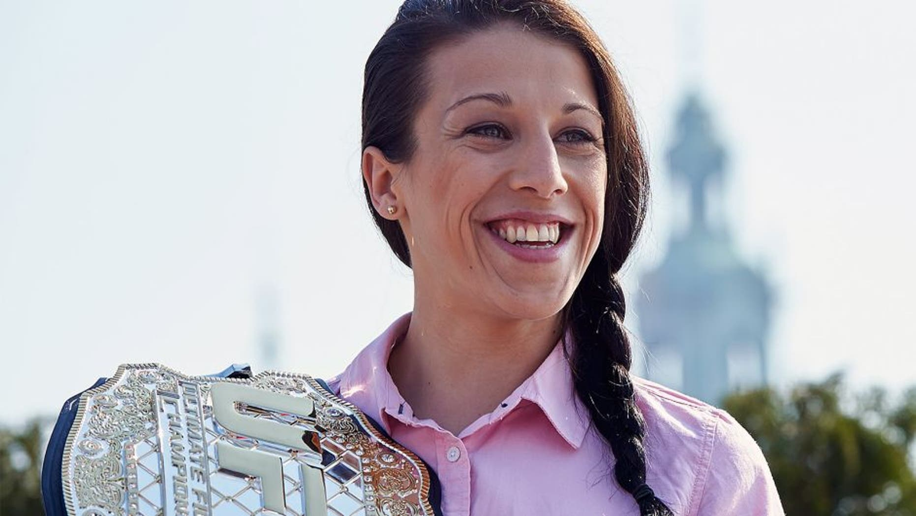 KRAKOW, POLAND - MARCH 20: Joanna Jedrzejczyk from Poland poses with UFC Champion Belt during a UFC photo session on roof terrace in Sheraton Hotel on March 20, 2015 in Krakow, Poland. (Photo by Adam Nurkiewicz/Zuffa LLC/Zuffa LLC via Getty Images)