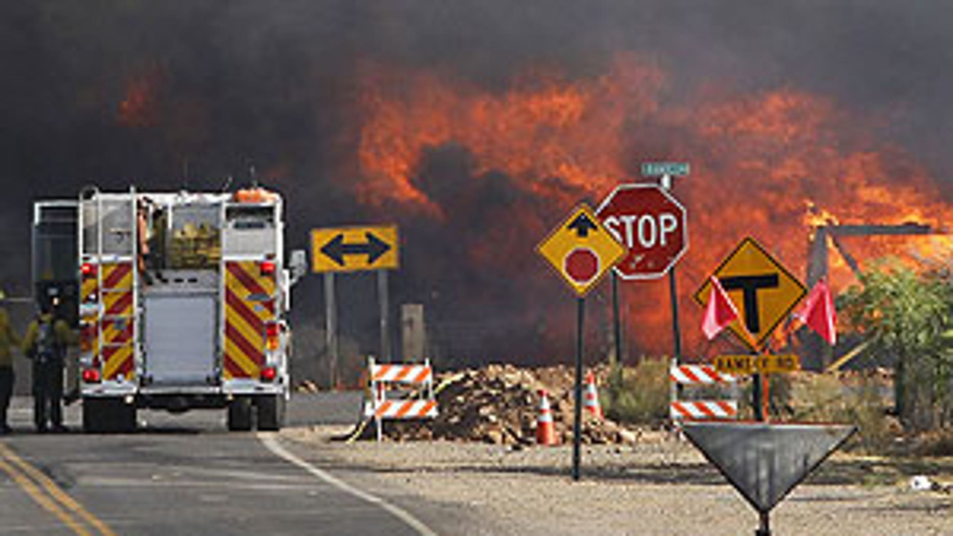 June 19: A home burns at the intersection of Campbello Ave. and Ramsey Rd. from the Monument Fire near Sierra Vista, Ariz.