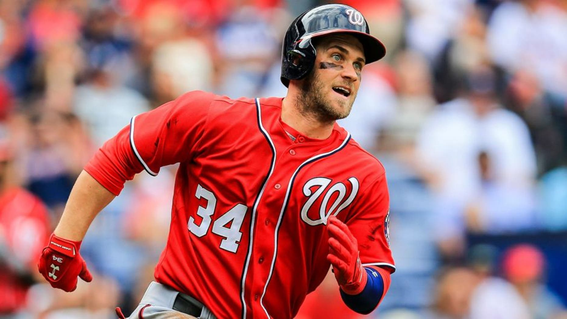 Apr 13, 2014; Atlanta, GA, USA; Washington Nationals left fielder Bryce Harper (34) runs to first on a double in the sixth inning against the Atlanta Braves at Turner Field. Mandatory Credit: Daniel Shirey-USA TODAY Sports