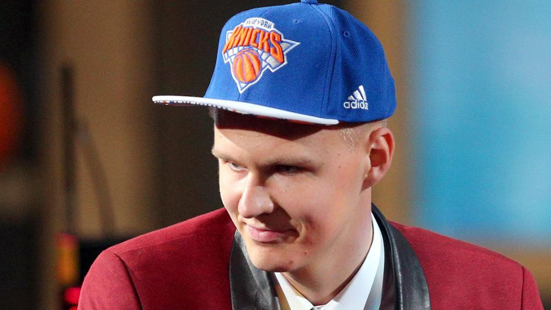 Jun 25, 2015; Brooklyn, NY, USA; Kristaps Porzingis (SPN) reacts after being selected as the number four overall pick to the Miami Heat in the first round of the 2015 NBA Draft at Barclays Center. Mandatory Credit: Brad Penner-USA TODAY Sports