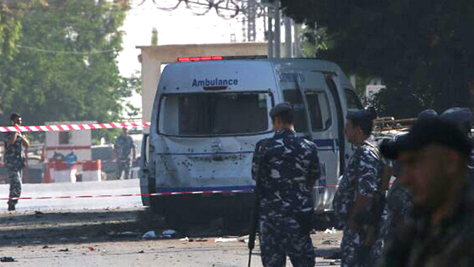 June 27, 2016: Lebanese policemen stand guard around a damaged ambulance that attacked by one of the suicide bombers, in Qaa, a predominantly Lebanese Christian village only few hundred meters (yards) away from the Syrian border, eastern Lebanon.