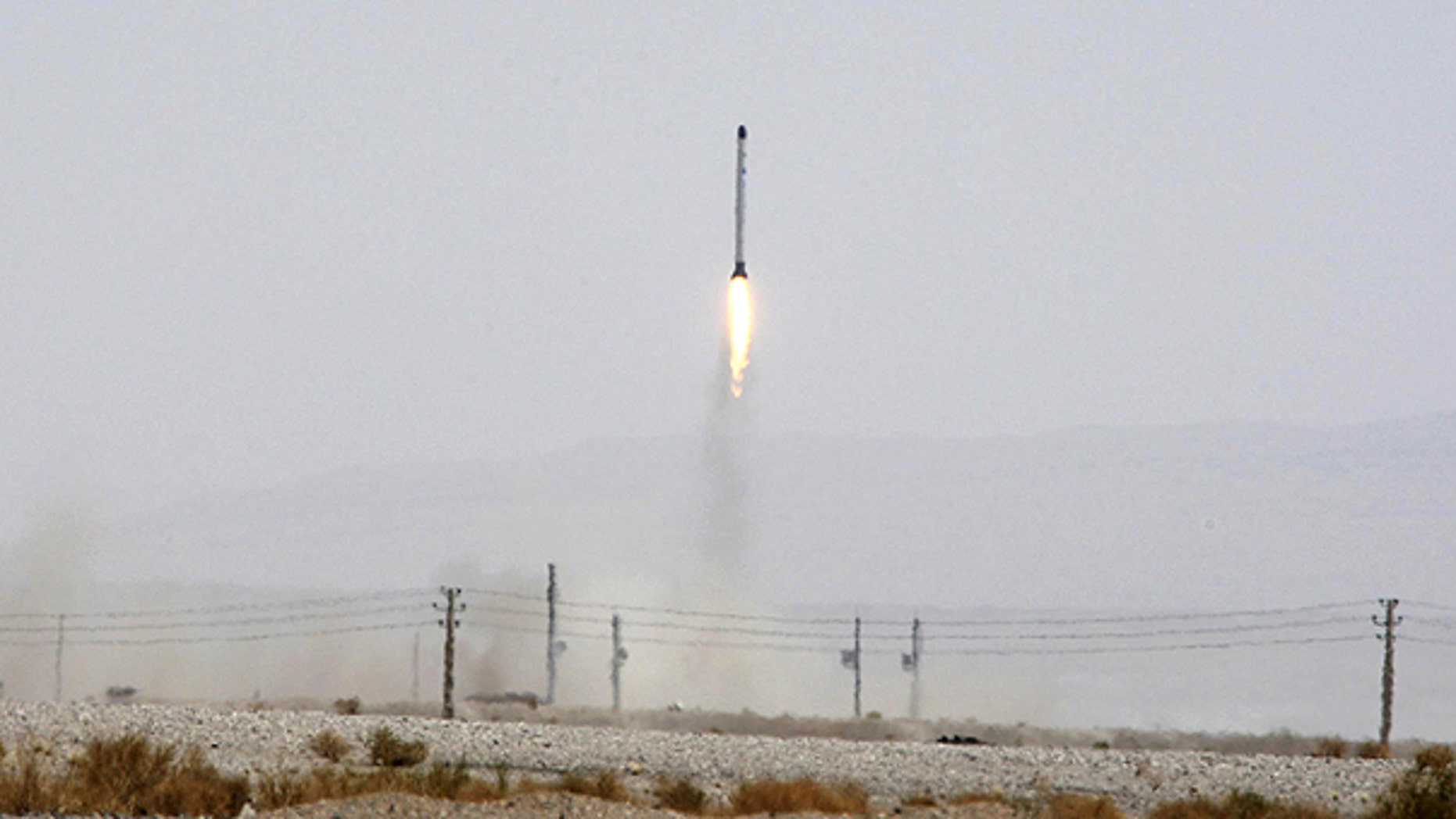 This file photo released June 16, 2011, by the Iranian Defense Ministry, claims to show launching the Safir, or Ambassador, satellite carrier, which carries Iran's Rasad, or Observation, satellite into earth orbit, in an undisclosed location.