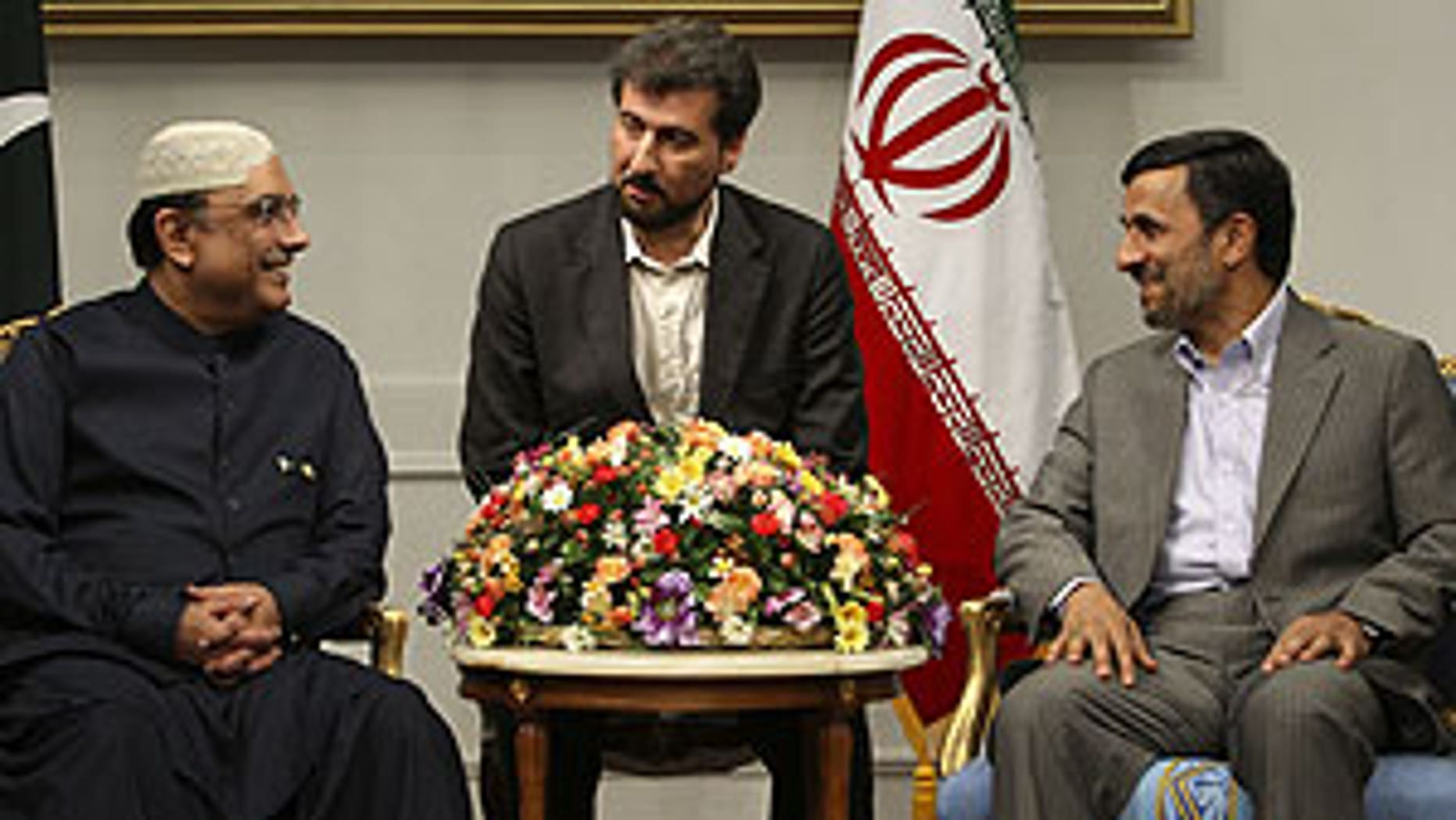 June 24: Iranian President Mahmoud Ahmadinejad, right, and his Pakistani counterpart Asif Ali Zardari meet at the Iranian presidency office in Tehran, Iran. At center is an unidentified interpreter.