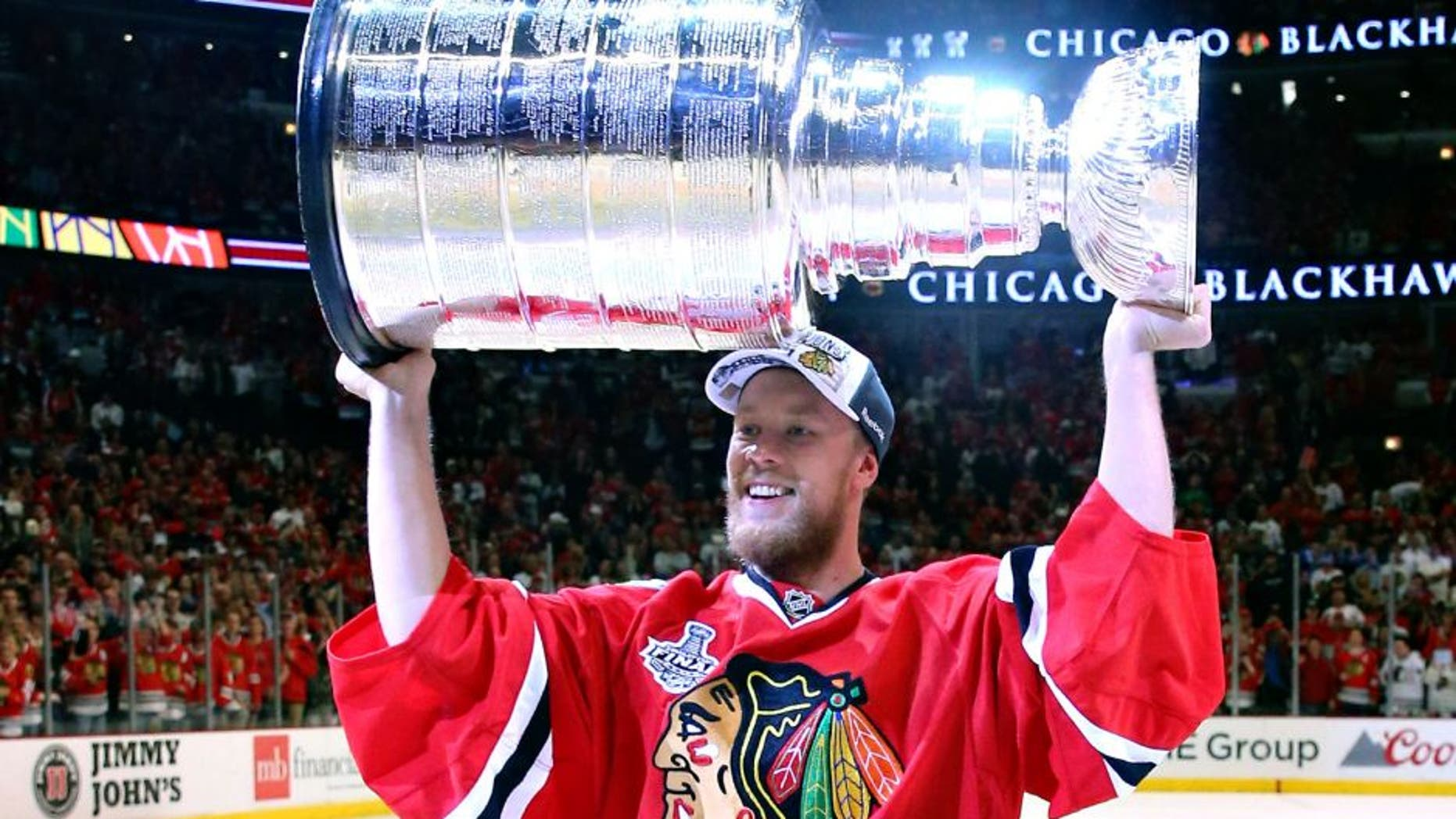 CHICAGO, IL - JUNE 15: Antti Raanta #31 of the Chicago Blackhawks celebrates with the Stanley Cup after defeating the Tampa Bay Lightning by a score of 2-0 in Game Six to win the 2015 NHL Stanley Cup Final at the United Center on June 15, 2015 in Chicago, Illinois. (Photo by Bruce Bennett/Getty Images)