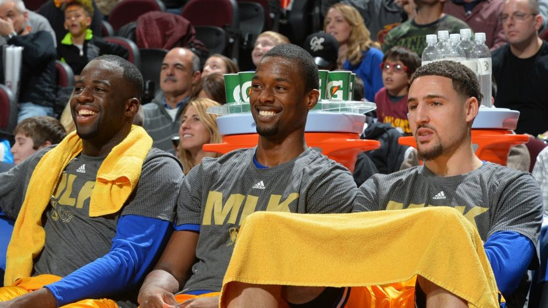CLEVELAND, OH - JANUARY 18: Harrison Barnes #40, Draymond Green #23 , Stephen Curry #30 and Klay Thompson #11 of the Golden State Warriors smiles from the bench against the Cleveland Cavaliers on January 18, 2016 at Quicken Loans Arena in Cleveland, Ohio. NOTE TO USER: User expressly acknowledges and agrees that, by downloading and/or using this Photograph, user is consenting to the terms and conditions of the Getty Images License Agreement. Mandatory Copyright Notice: Copyright 2016 NBAE (Photo by Jesse D. Garrabrant/NBAE via Getty Images)