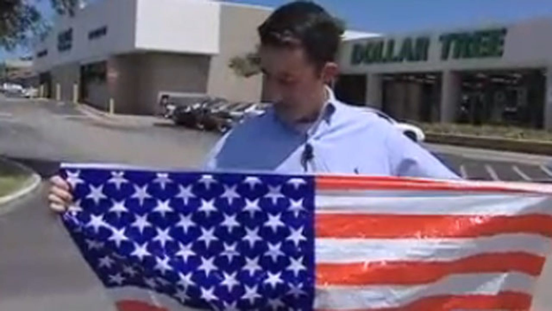 Tim Childress holds the American flag with 61 stars he purchased at a Dallas store.