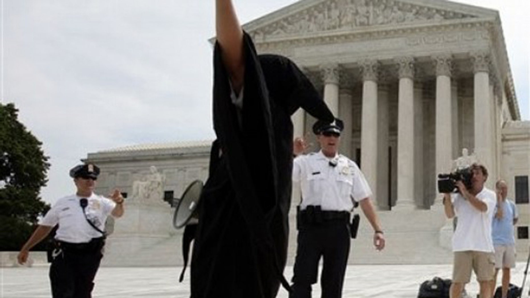 Anti-abortion protesters demonstrate in front of the Supreme Count in Washington, Monday, June 28, 2010. (AP)
