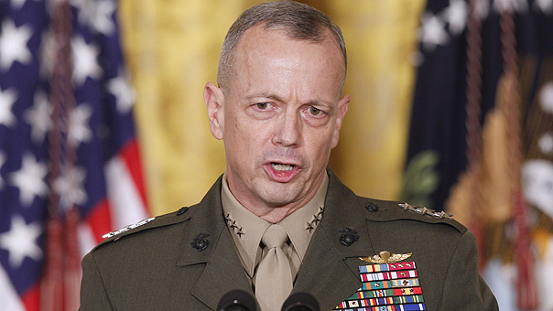 In an April 28, 2011 file photo Marine Corps Lt. Gen. John Allen, speaks in the East Room of the White House in Washington. Allen who will take over as the top U.S. commander in Afghanistan endorsed the size and pace of the more than 30,000-troop withdrawal laid out by President Obama.