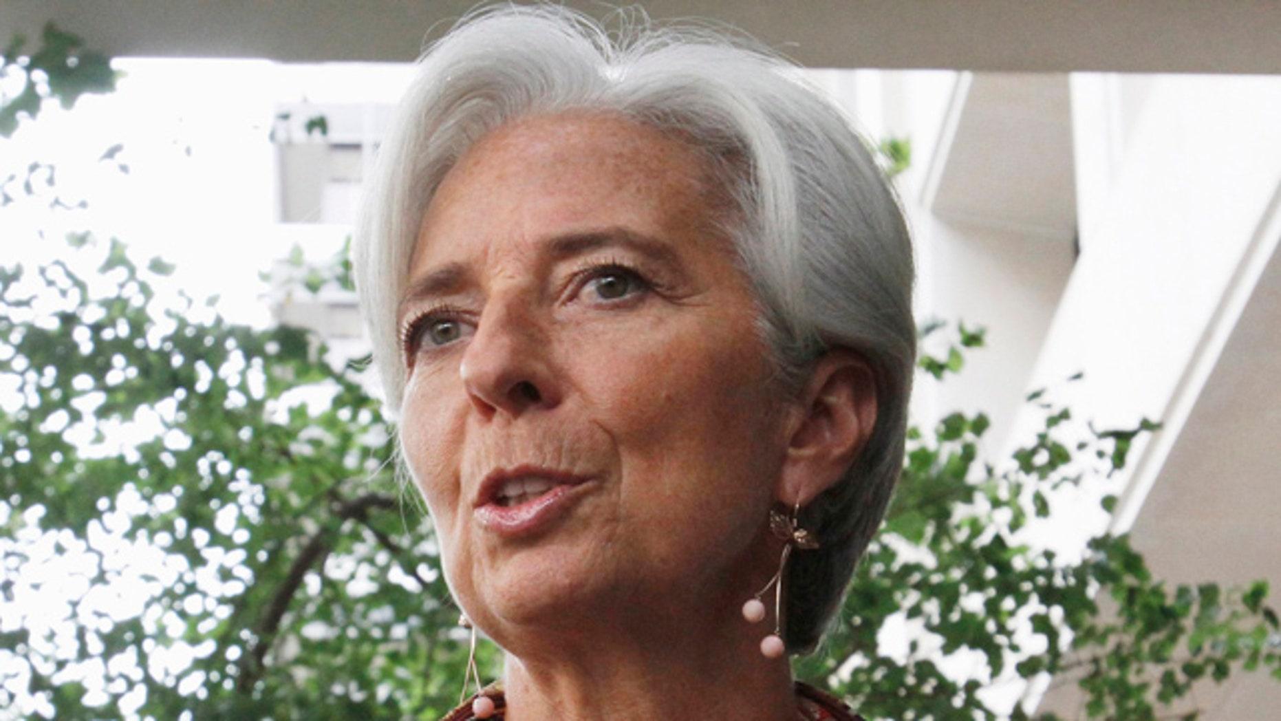 June 23: French Finance Minister Christine Lagarde speaks to the media outside the International Monetary Fund in Washington.