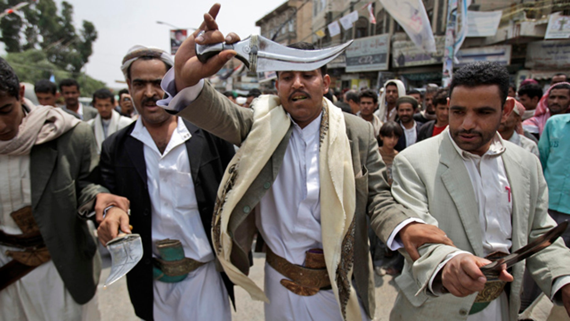 June 28: Anti-government protestors dance holding their daggers during a demonstration demanding the resignation of Yemeni President Ali Abduallah Saleh, in Sanaa, Yemen.