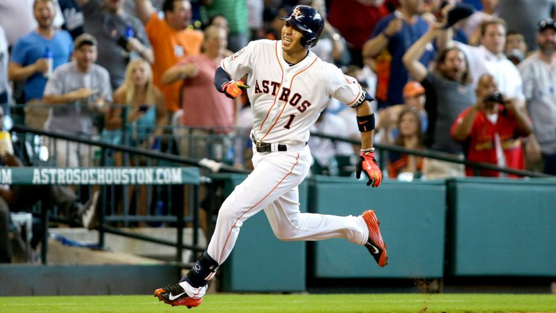 Jun 28, 2015; Houston, TX, USA; Houston Astros shortstop Carlos Correa (1) rounds third base to score a run during the fourth inning against the New York Yankees at Minute Maid Park. Mandatory Credit: Troy Taormina-USA TODAY Sports