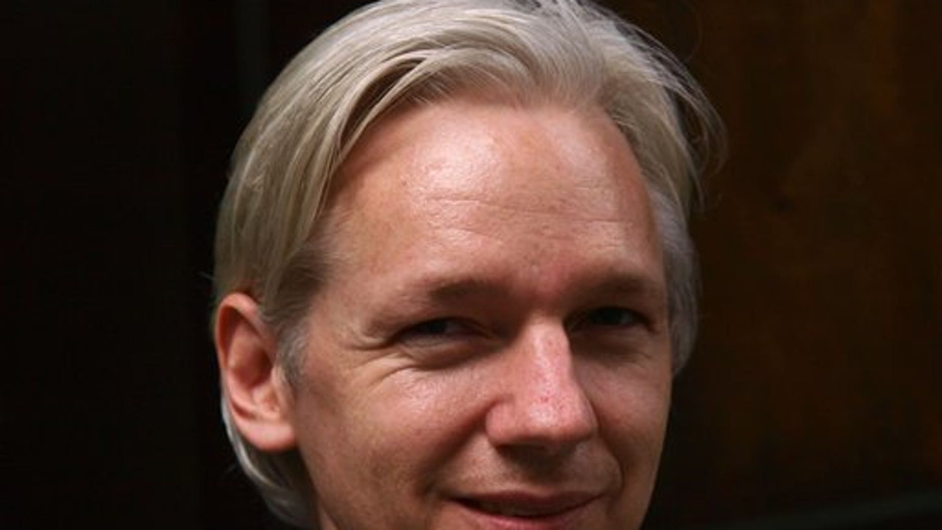 FILE: Founder and editor of the WikiLeaks website, Julian Assange, speaks to members of the media during a debate event held in London.