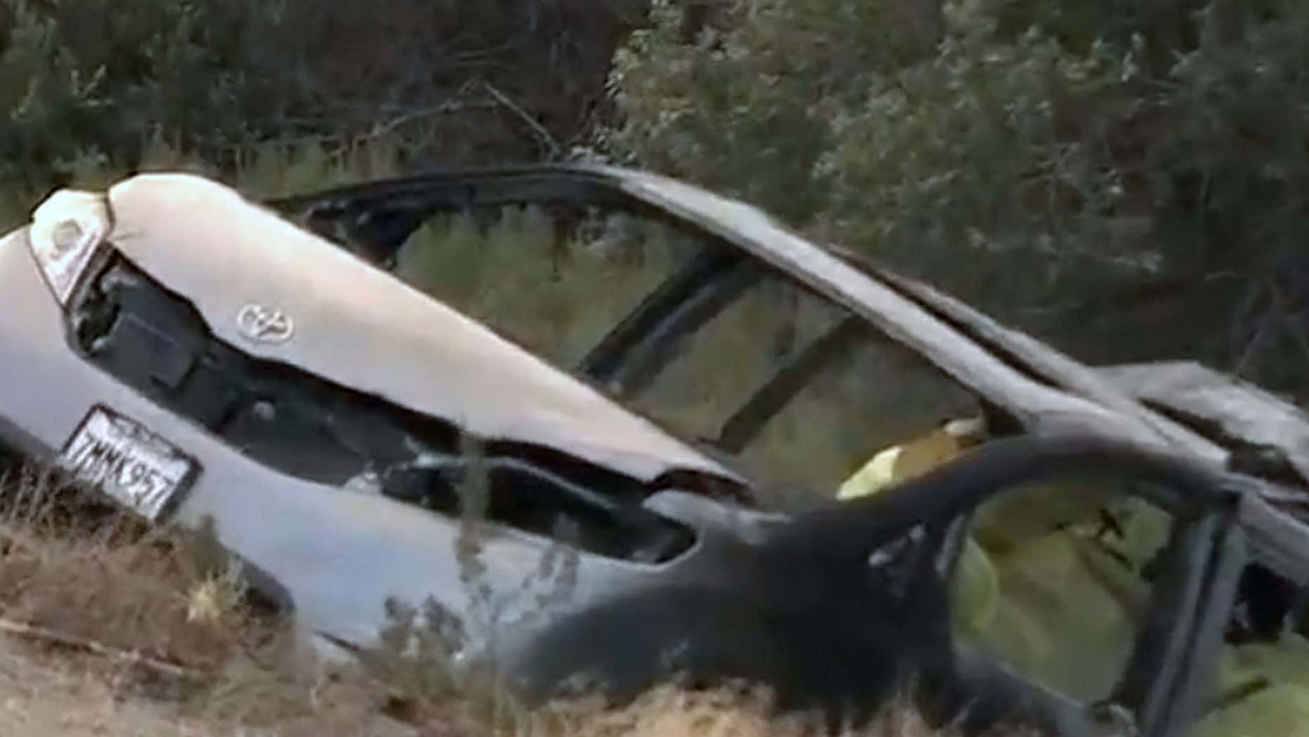 June 28, 2016: In this image made from video, a minivan burned on the side of Interstate 5, near the community of Gorman in Tejon Pass, about 65 miles north of downtown Los Angeles.
