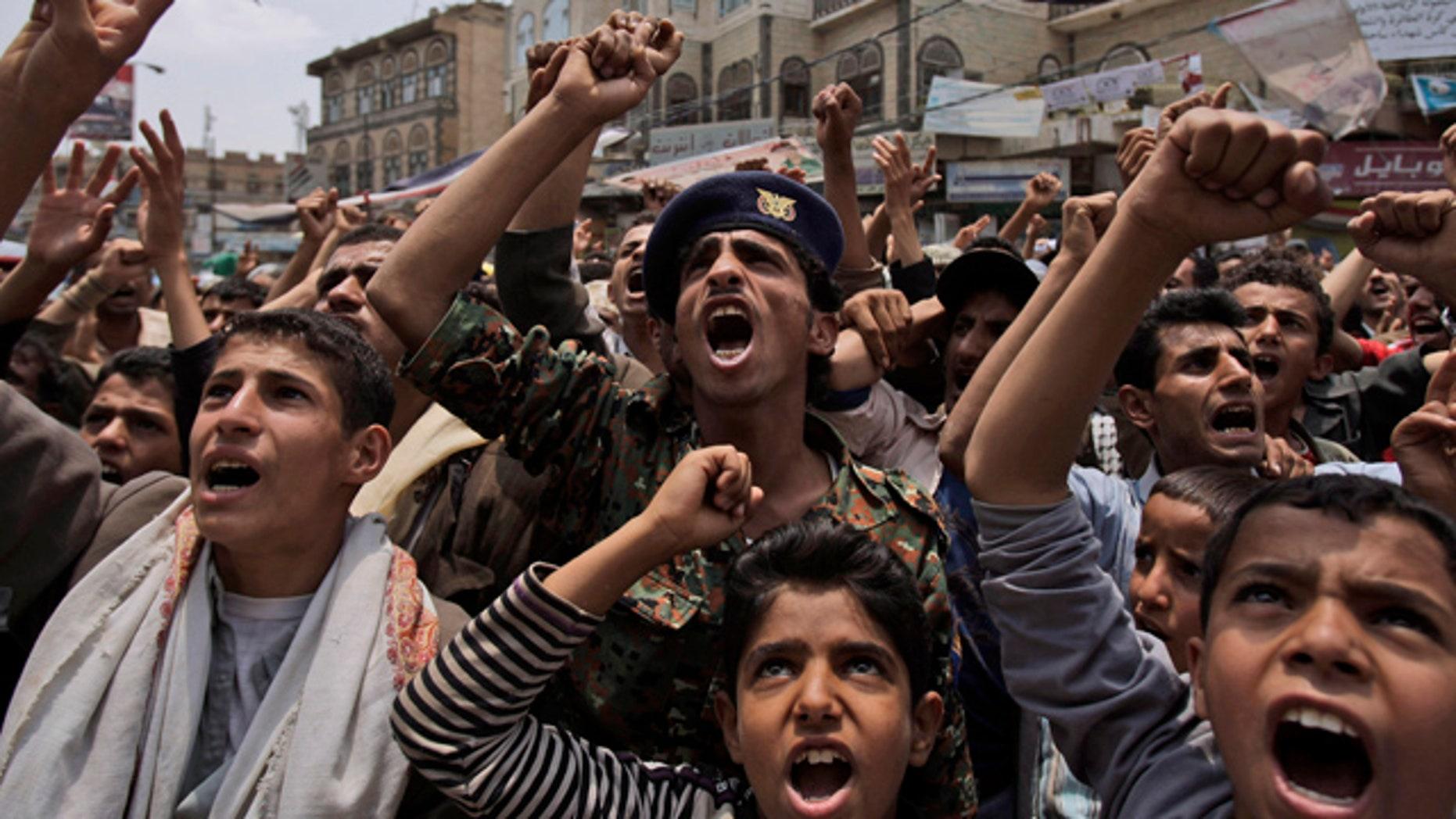 June 29: Anti-government protestors shout slogans during a demonstration demanding the resignation of Yemeni President Ali Abdullah Saleh in Sanaa, Yemen.