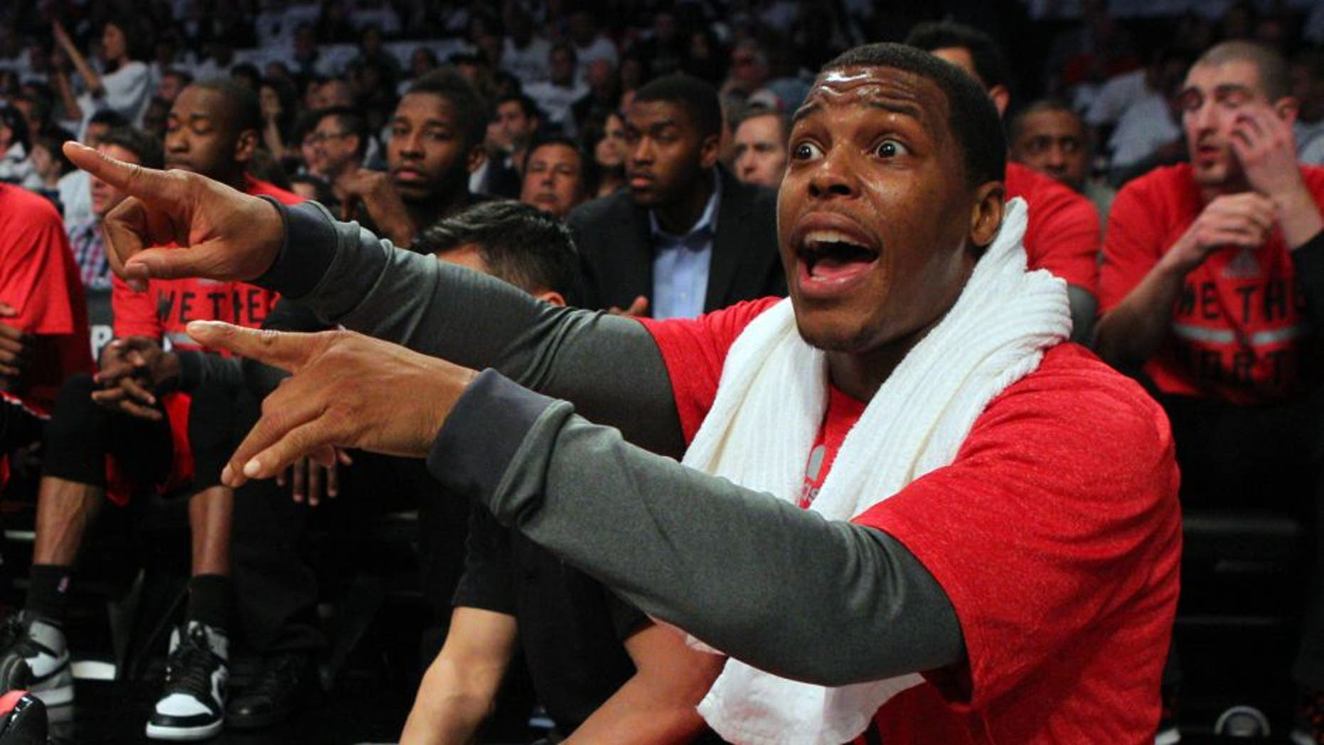 May 2, 2014; Brooklyn, NY, USA; Toronto Raptors point guard Kyle Lowry (7) calls out to a teammate from the bench during the second quarter of game six of the first round of the 2014 NBA Playoffs against the Brooklyn Nets at Barclays Center. Mandatory Credit: Brad Penner-USA TODAY Sports