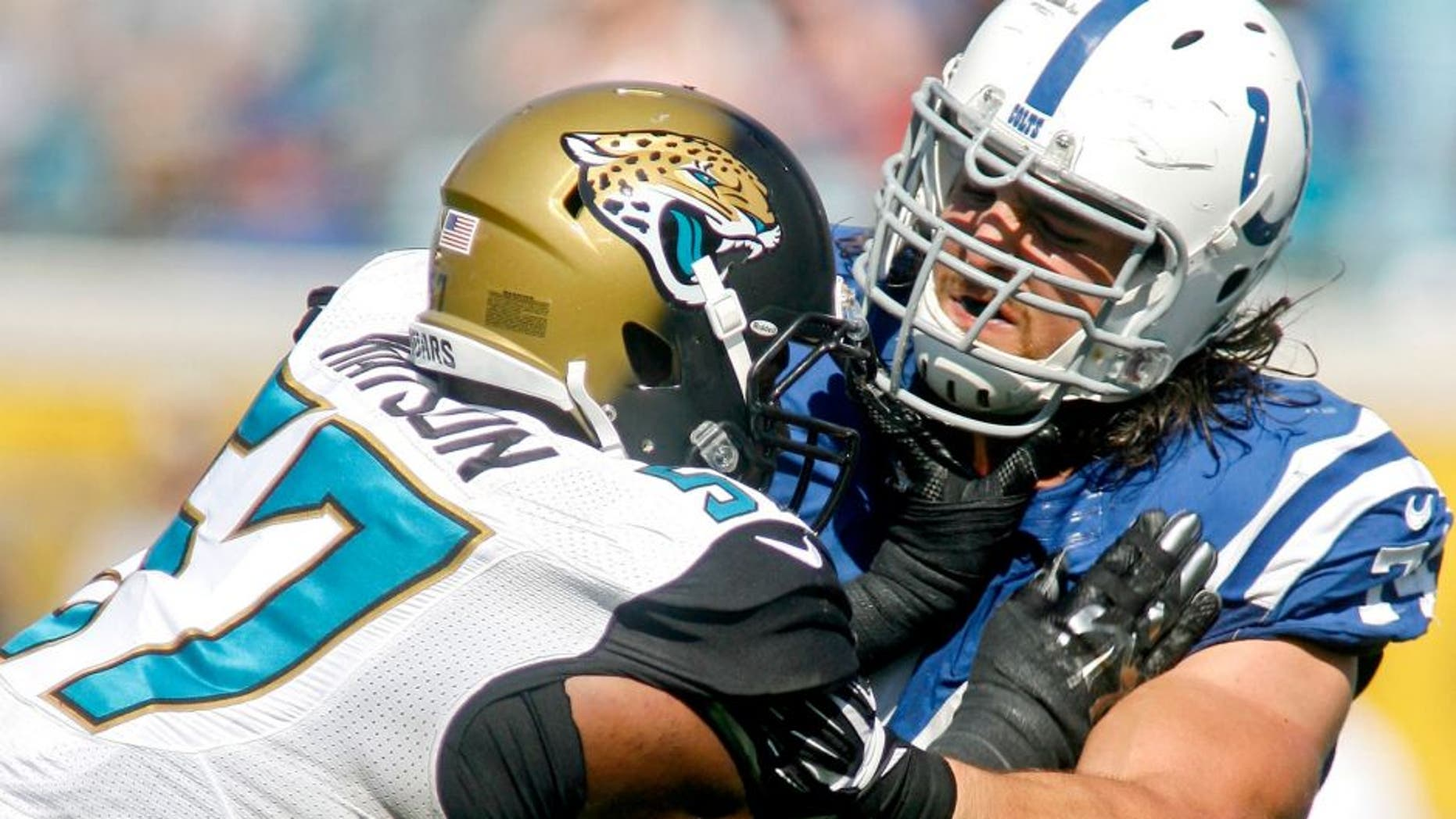 Sep 21, 2014; Jacksonville, FL, USA; Jacksonville Jaguars linebacker Dekoda Watson (57) is blocked by Indianapolis Colts tackle Anthony Castonzo (74) in the fourth quarter of their game at EverBank Field. The Colts won 44-17. Mandatory Credit: Phil Sears-USA TODAY Sports