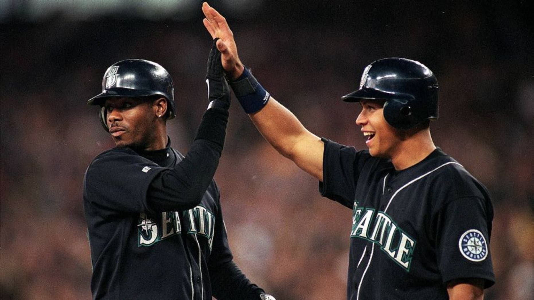 17 Jul 1999: Ken Griffey Jr. #24 and Alex Rodriguez #3 of the Seattle Mariners hi-fiveing each other during the game against the San Diego Padres at Safeco Field in Seattle, Washington. The Mariners defeated the Padres 9-1. Mandatory Credit: Otto Greule Jr. /Allsport