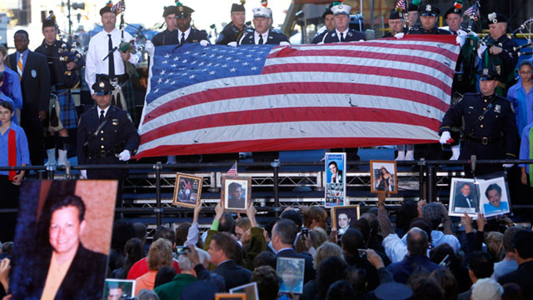The World Trade Center flag is presented as friends and relatives of the victims of the Sept. 11, 2001 attacks gather for a commemoration ceremony at Zuccotti Park, adjacent to ground zero, on the ninth anniversary of the terrorist attacks on the World Trade Center, Saturday, Sept. 11, 2010 in New York.