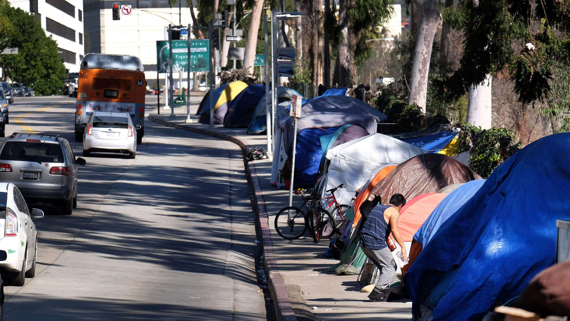 FILE - In this Jan. 26, 2016, file photo, tents from a homeless encampment line a street in downtown Los Angeles.