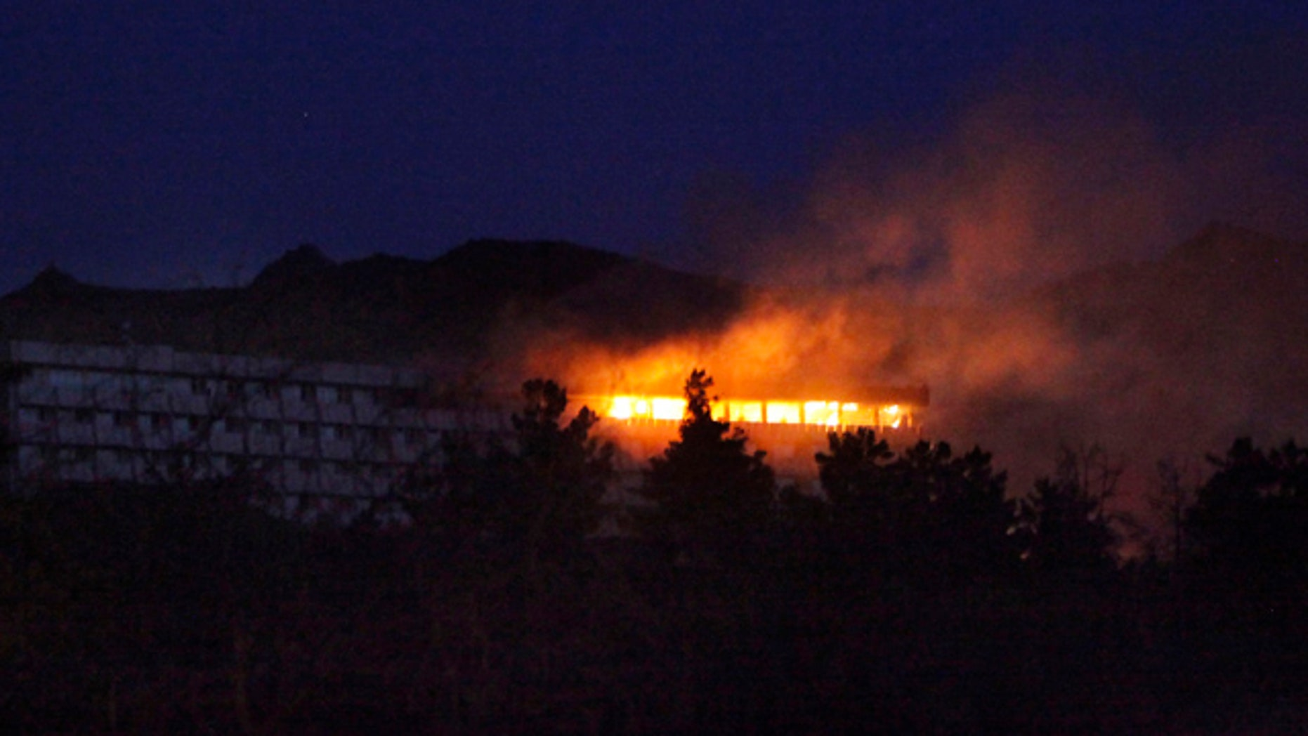 June 29: Western-style Inter-Continental hotel is on fire during an attack in Kabul, Afghanistan.