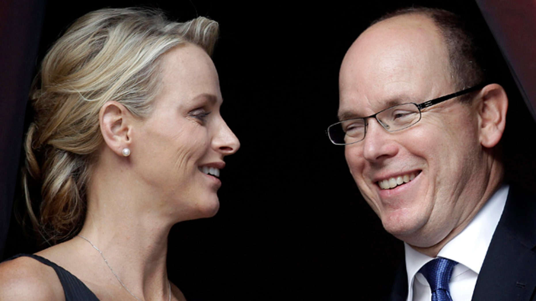June 23: Prince Albert II of Monaco and his fiancee Charlene Wittstock attend the St. Jean Religious Parade in Monaco.