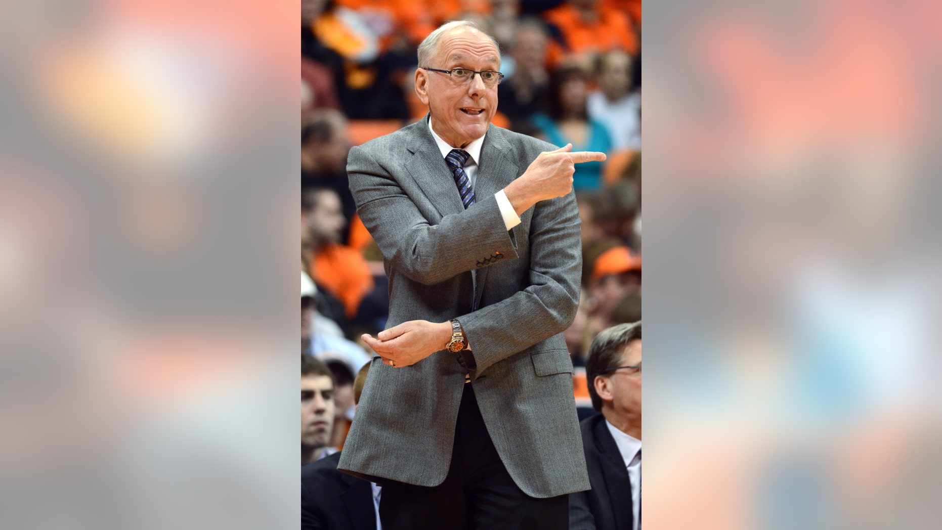 Syracuse head coach Jim Boeheim gestures to his players during the second half against Providence in an NCAA college basketball game in Syracuse, N.Y., Wednesday, Feb. 20, 2013. Syracuse won 84-59. (AP Photo/Kevin Rivoli)