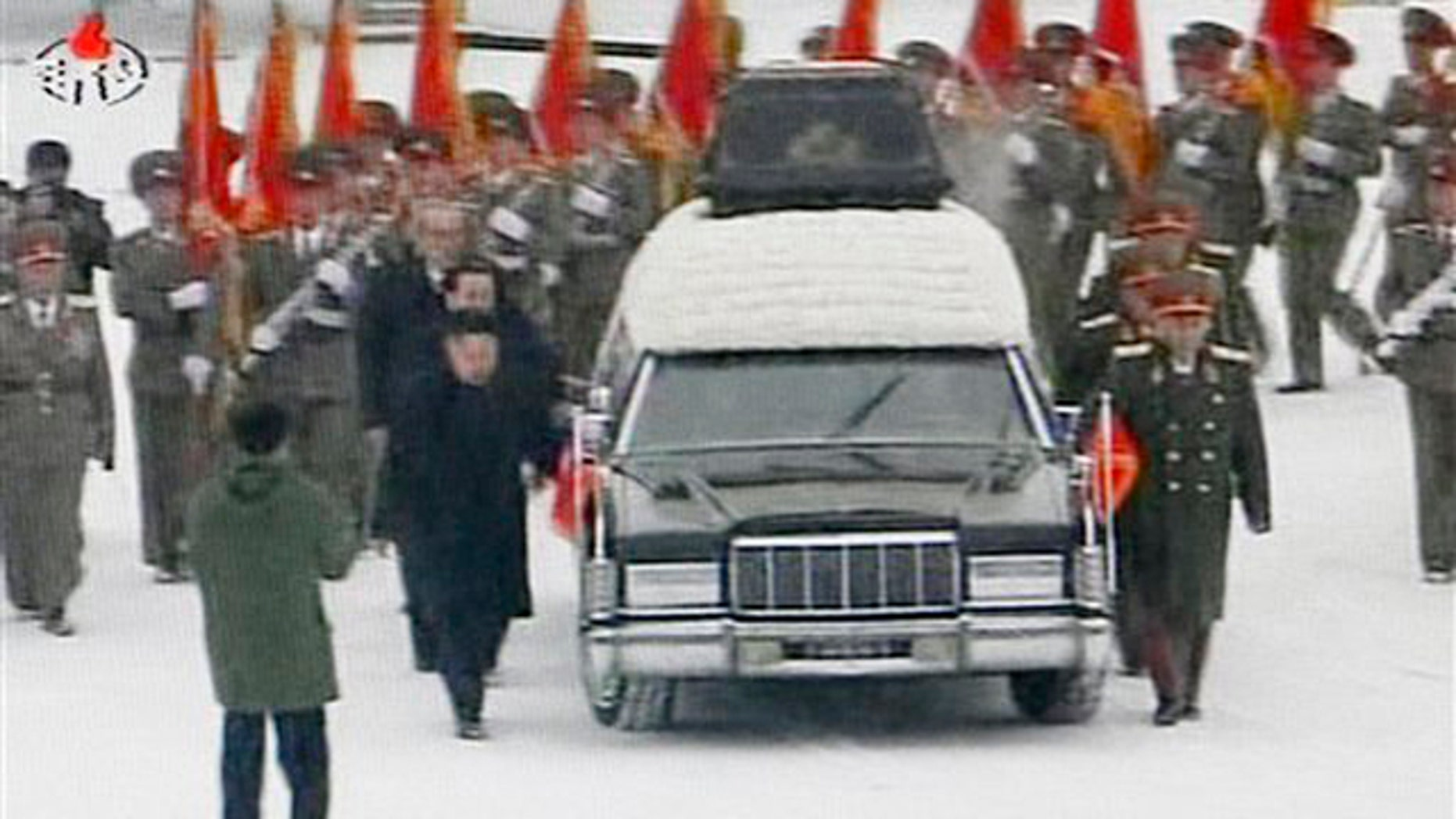 December 28, 2011: In this image made from KRT television, a hearse is driven during a funeral procession of late North Korean leader Kim Jong Il in the snow in Pyongyang, North Korea.