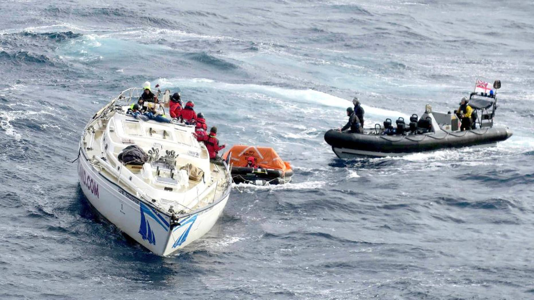 In this photo provided by the Ministry of Defence on Sunday, Feb. 12, 2017, crew from the Royal Navy's Type 45 destroyer HMS Dragon, man a large sea boat as they help to rescue crew members from a racing yacht in the Atlantic Ocean. Britain's Royal Navy says a warship has rescued 14 sailors after their racing yacht lost its mast, leaving them stranded in the mid- Atlantic. Britain's Coast Guard received a mayday signal from the 60-foot (18-meter) Clyde Challenger late Thursday. (Royal Navy/MOD via AP)