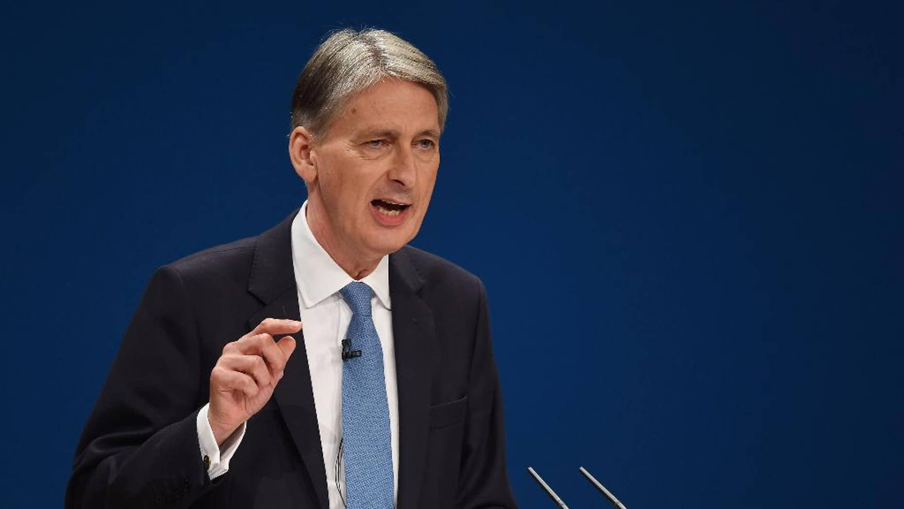 Britain's Chancellor of the Exchequer Philip Hammond speaks on the second day of the Conservative party conference in Birmingham, England, Monday Oct. 3, 2016. Philip Hammond told the BBC on Monday that Britain will face a couple of years, or longer, of uncertainty as Britain goes through the process of leaving the 28-nation trading bloc. (Joe Giddens/PA via AP)