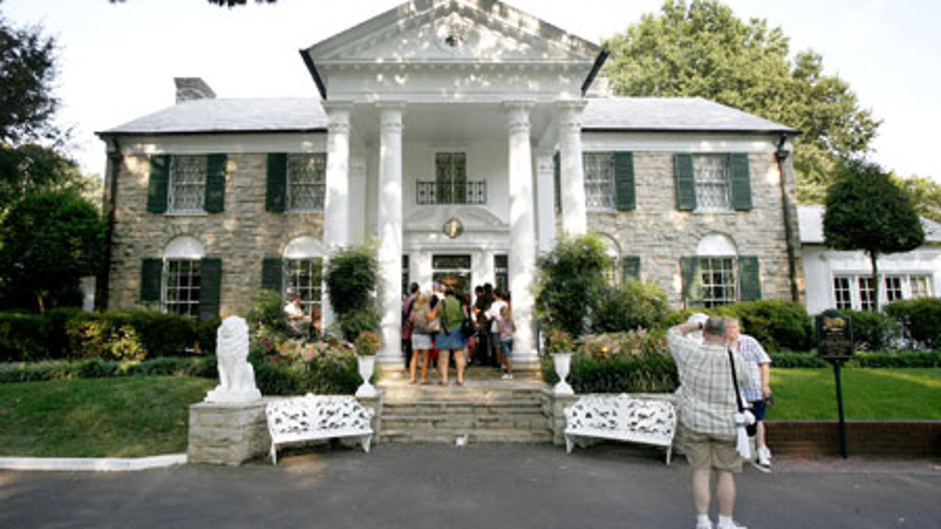 The Graceland estate and mansion is the former home of rock legend Elvis Presley and is now the site of a museum dedicated to the king of rock and roll. An annual procession is held that allows fans to travel through the estate and past Elvis' grave on the anniversary of his death. In 2002, it was estimated that a whopping 40,000 people attended the procession, despite pouring rain.