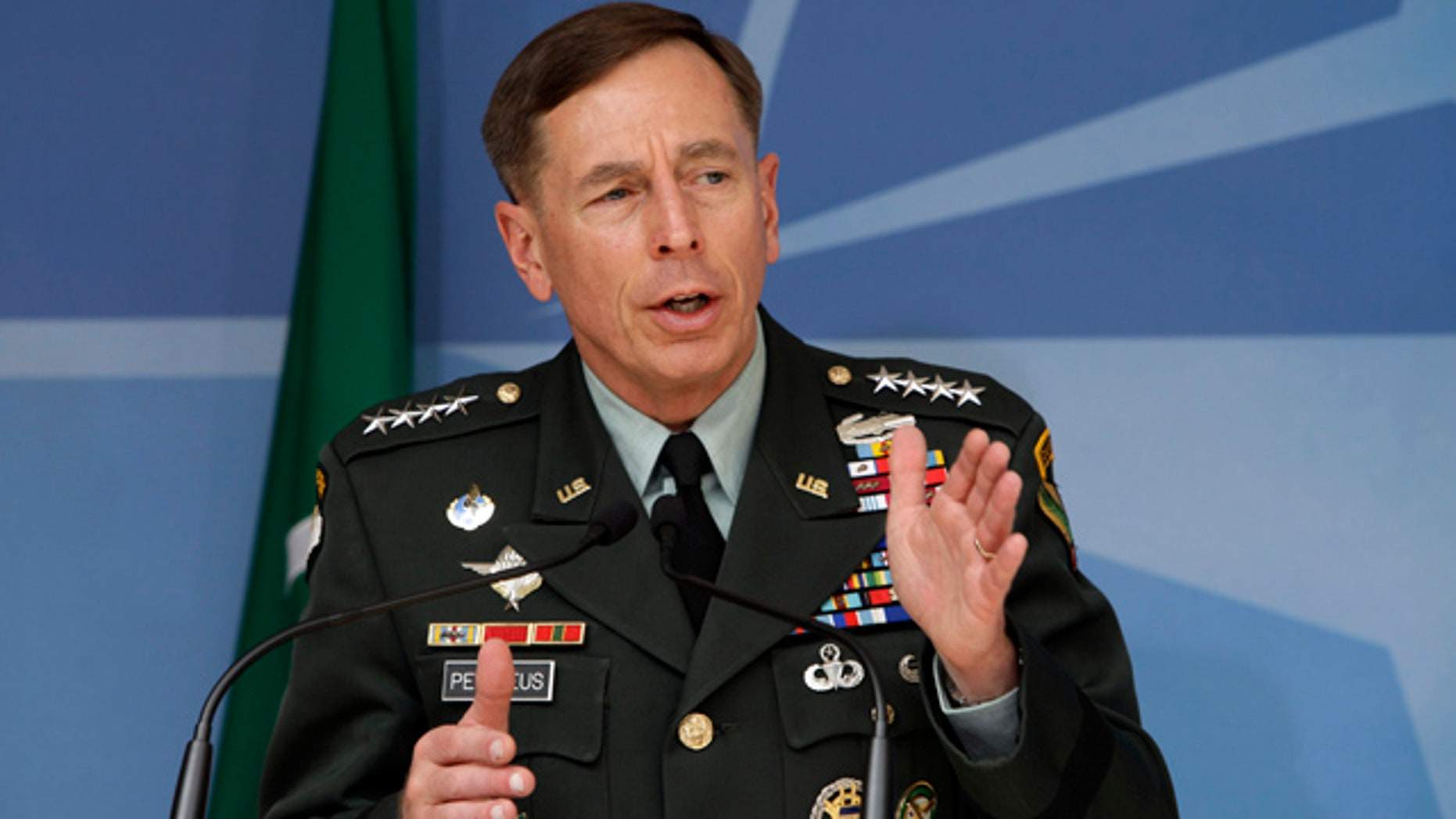Newly appointed U.S. and NATO forces commander in Afghanistan U.S. Army General David Petraeus speaks during a media conference at NATO headquarters in Brussels on Thursday, July 1, 2010.  (AP Photo/Virginia Mayo)