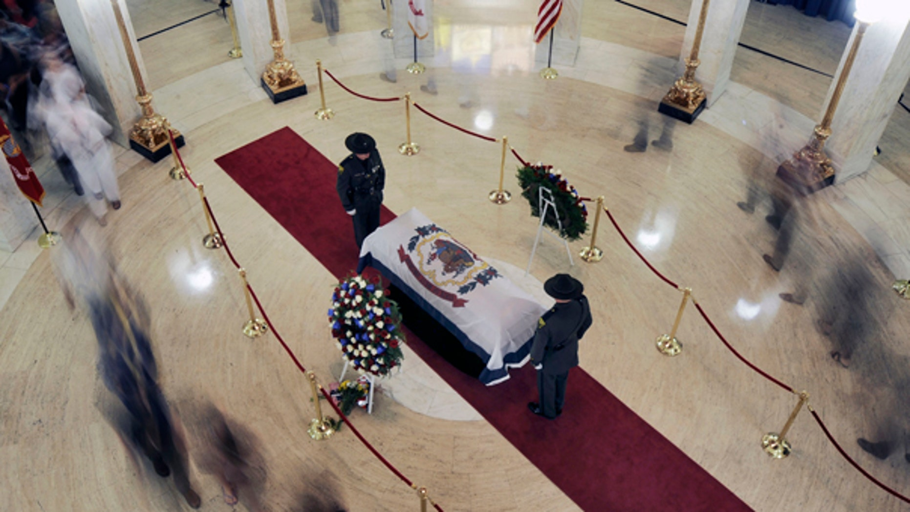 July 1: People file past Sen. Byrd's casket in the Charleston, W.Va. capitol building.