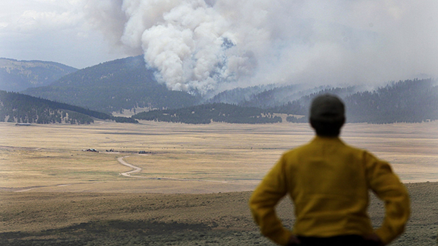 June 30: A television producer watches smoke from the Las Conchas fire near Los Alamos, N.M.