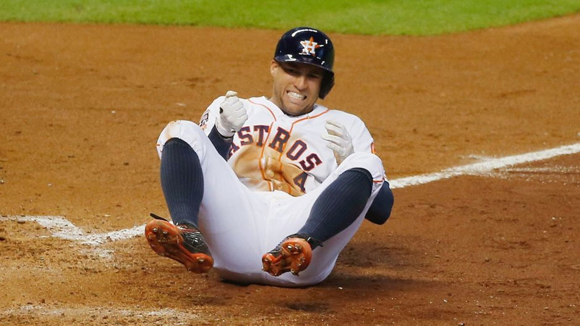 HOUSTON, TX - JULY 01: George Springer #4 of the Houston Astros gets hit by a pitch in the fifth inning during their game against the Kansas City Royals at Minute Maid Park on July 1, 2015 in Houston, Texas. (Photo by Scott Halleran/Getty Images)