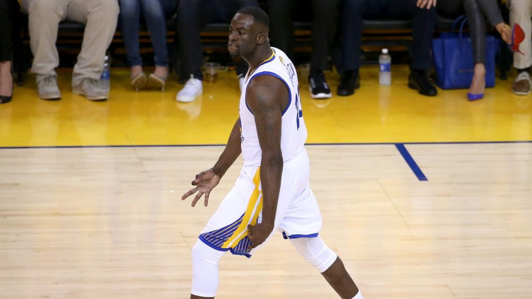 Jun 14, 2015; Oakland, CA, USA; Golden State Warriors forward Draymond Green (23) reacts after a three pointer during the first quarter against the Cleveland Cavaliers in game five of the NBA Finals at Oracle Arena. Mandatory Credit: Kelley L Cox-USA TODAY Sports