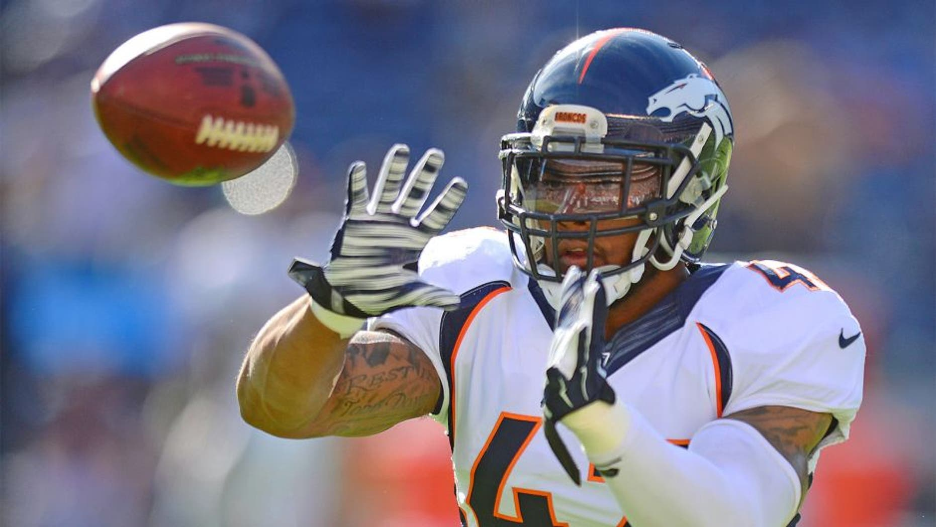 Dec 14, 2014; San Diego, CA, USA; Denver Broncos strong safety T.J. Ward (43) catches a pass before the game against the San Diego Chargers at Qualcomm Stadium. Mandatory Credit: Jake Roth-USA TODAY Sports